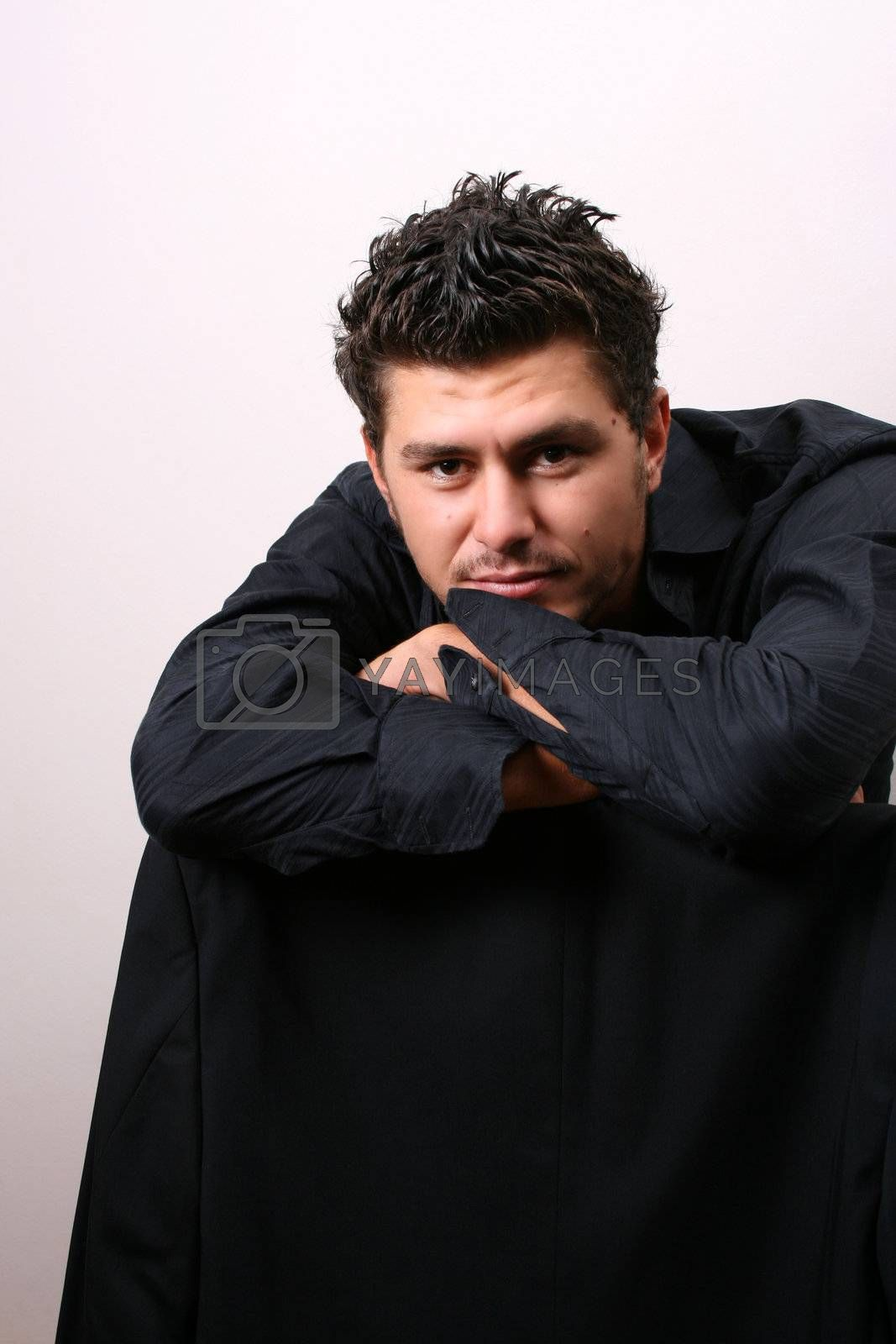 Male model in studio against white wall