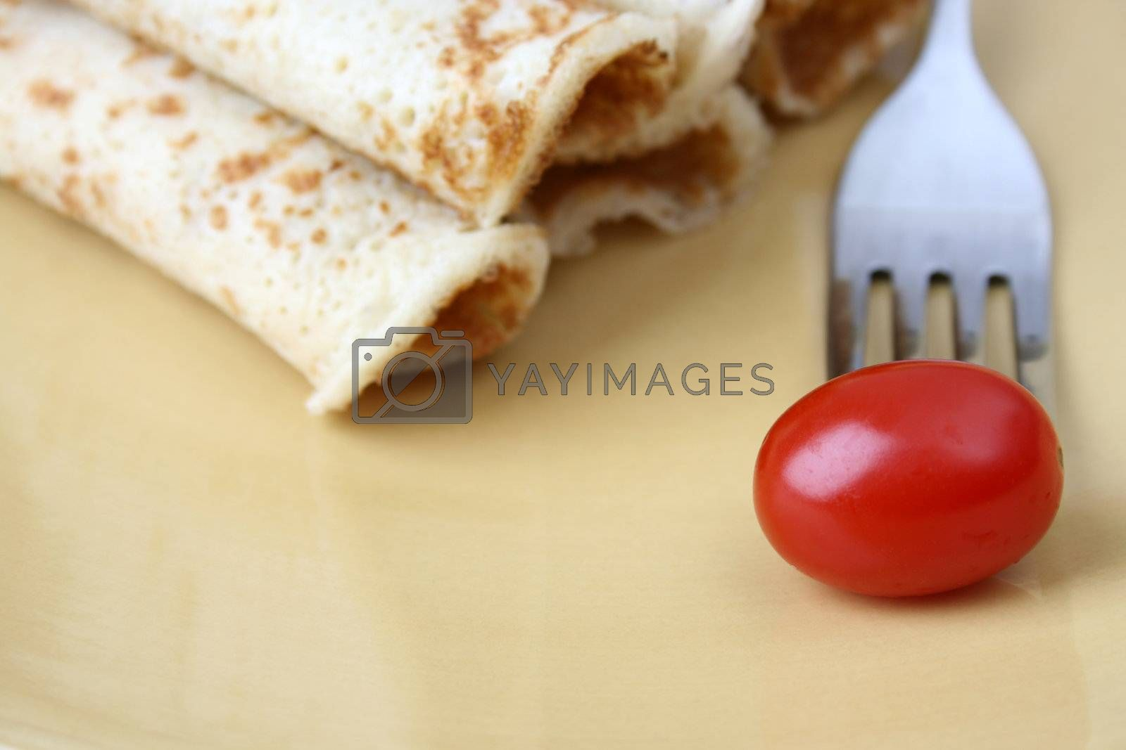Barbeque Chicken Pancakes with a single tomato