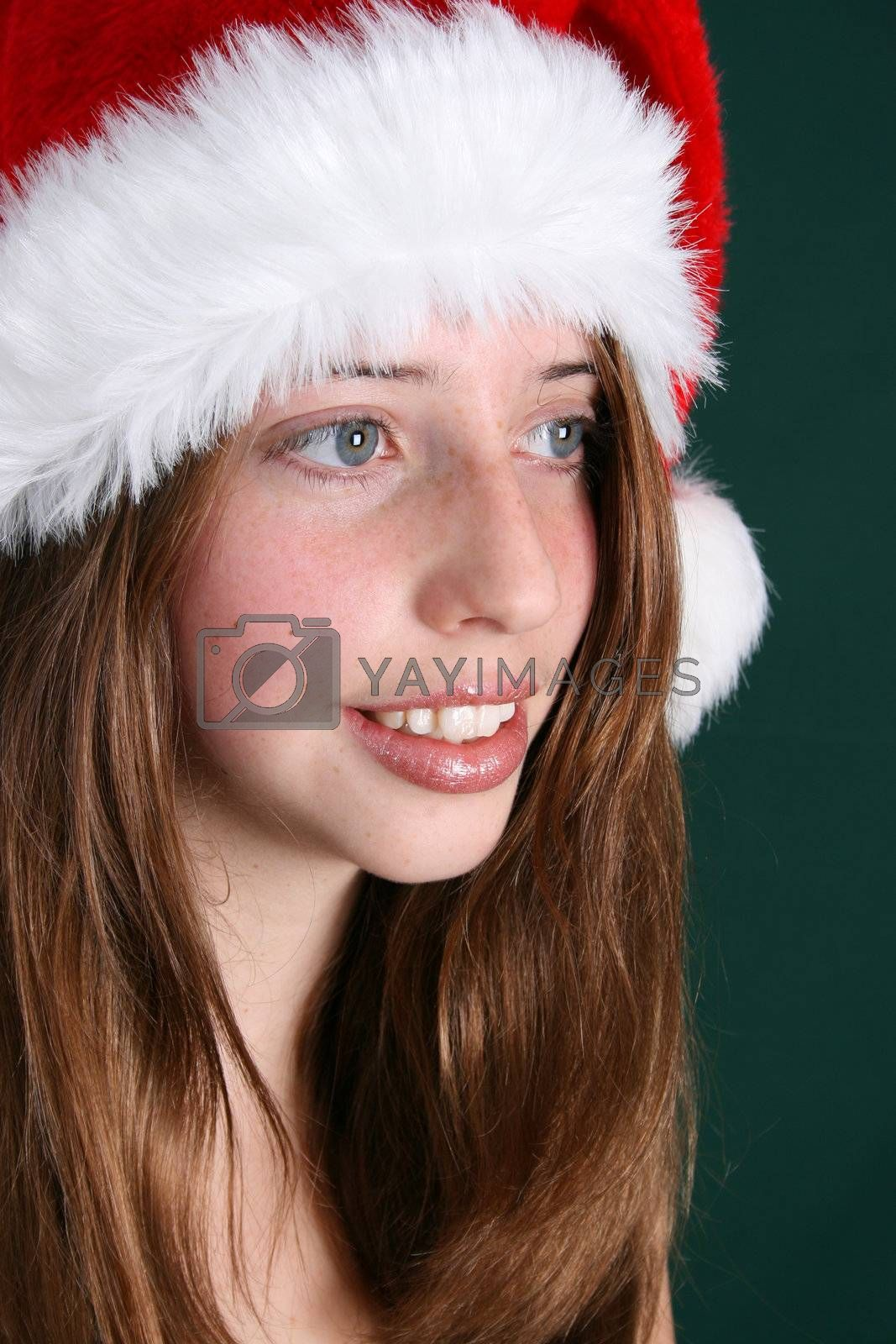 Brunette Teenager wearing a fluffy christmas hat
