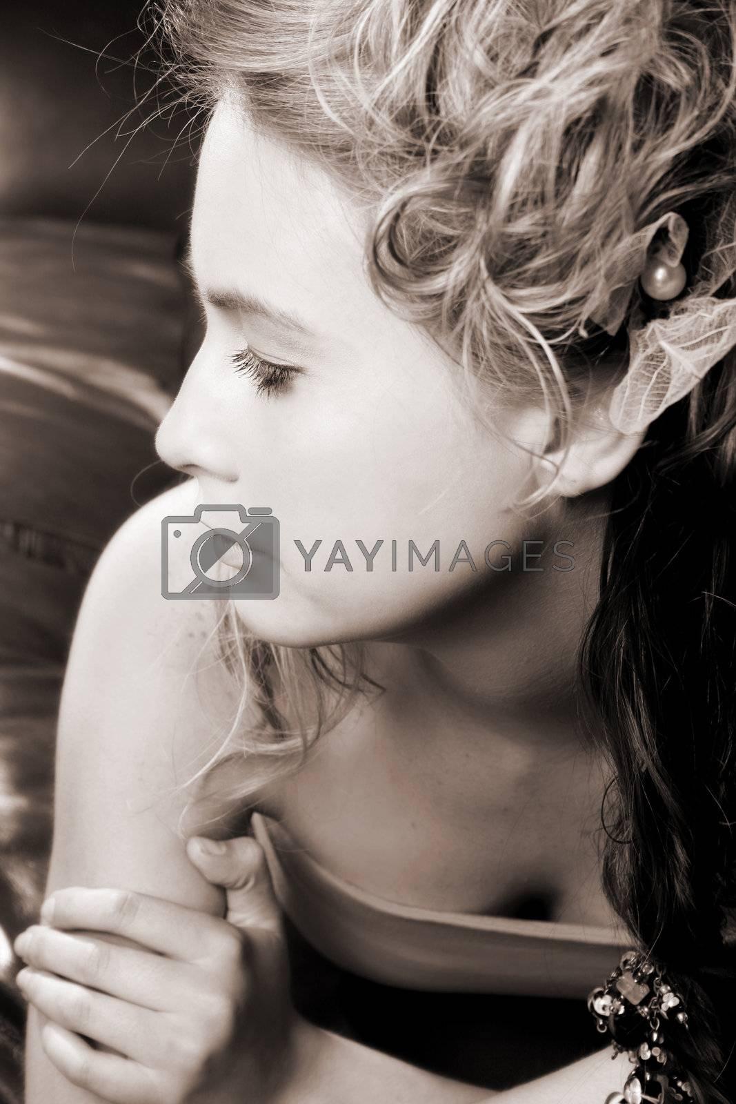 Beautiful female model jewelery and hair styled