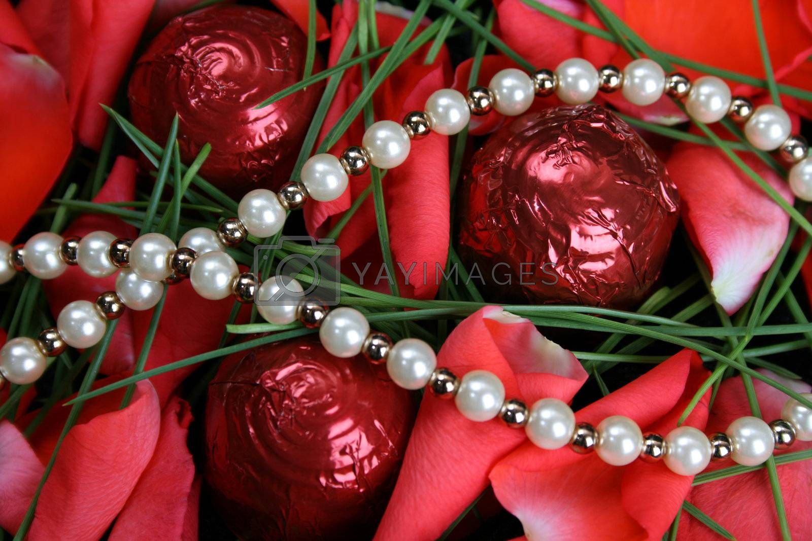 Valetines day pearls with chocolates and petals