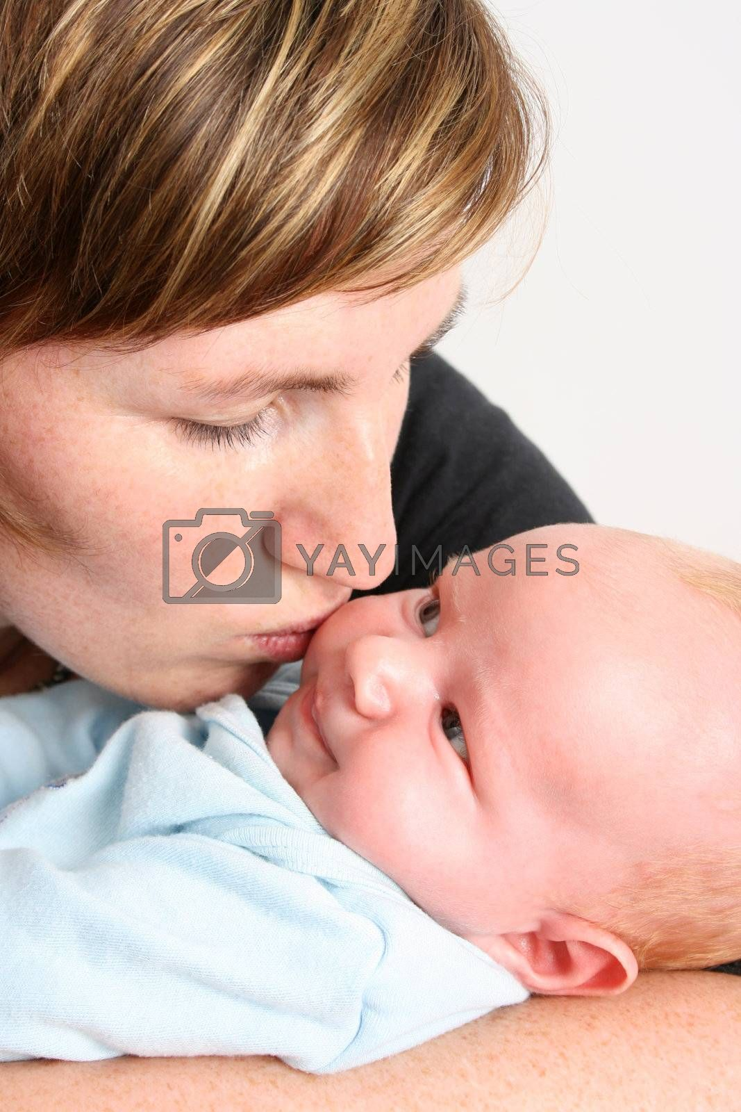 Loving mother holding her new baby boy