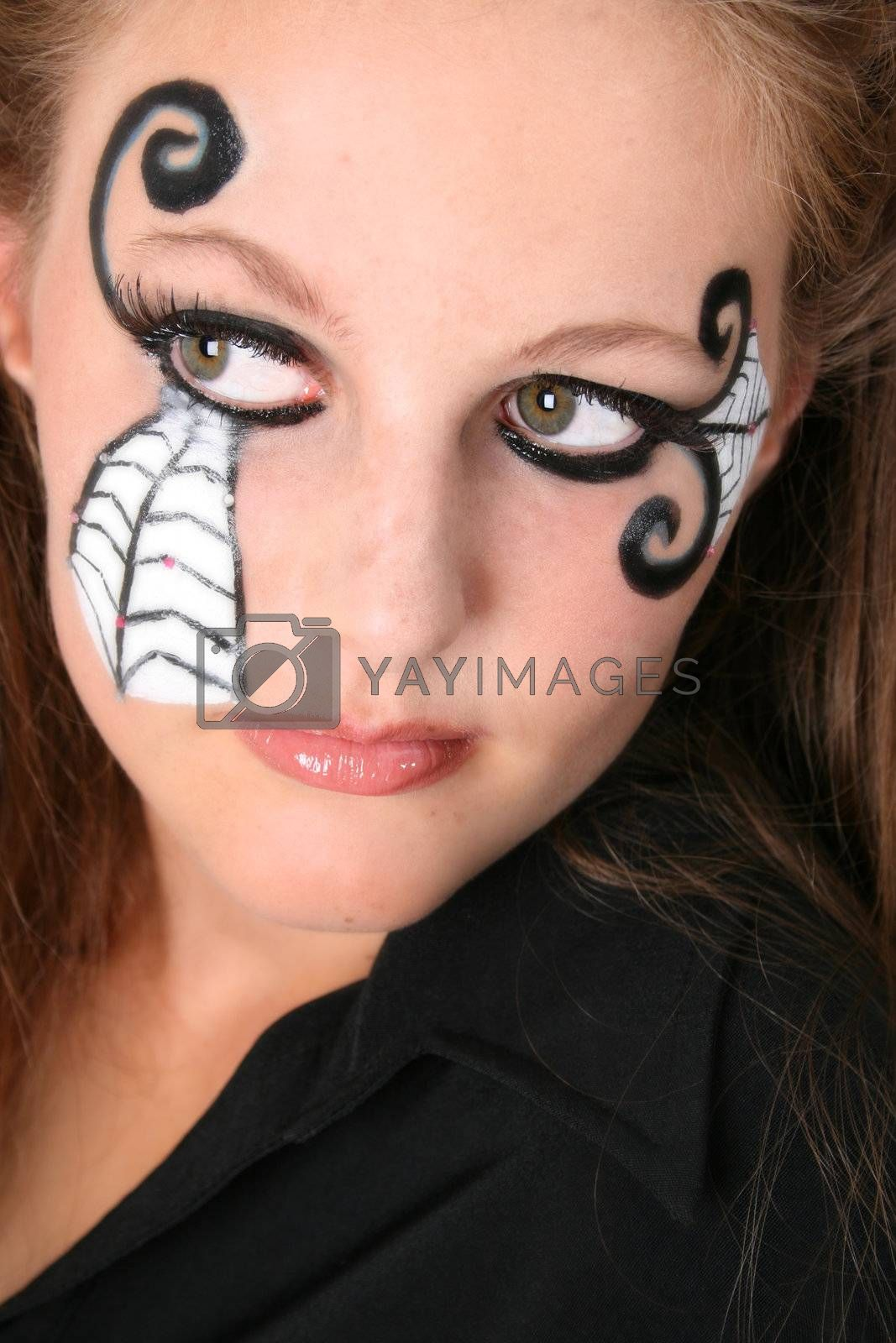 Close-up of Halloween teenager with face paint