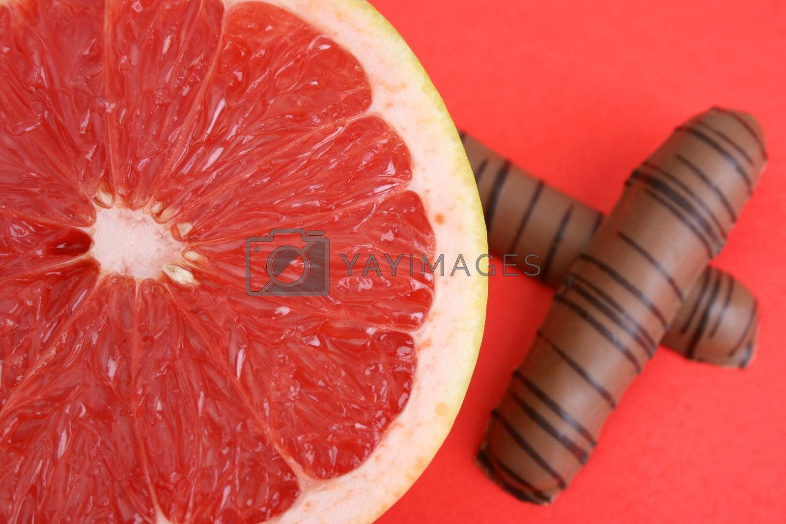 Half Sliced Pomelo and chocolate on a bright background
