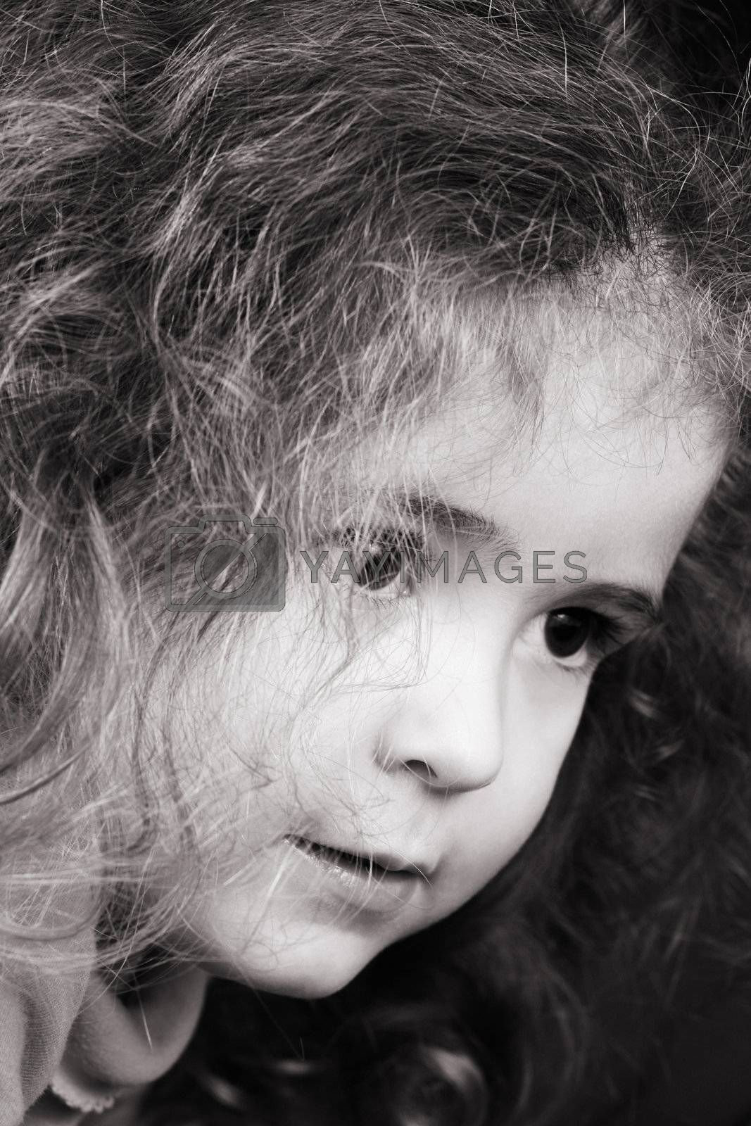 Beautiful young girl with curly hair and cute features