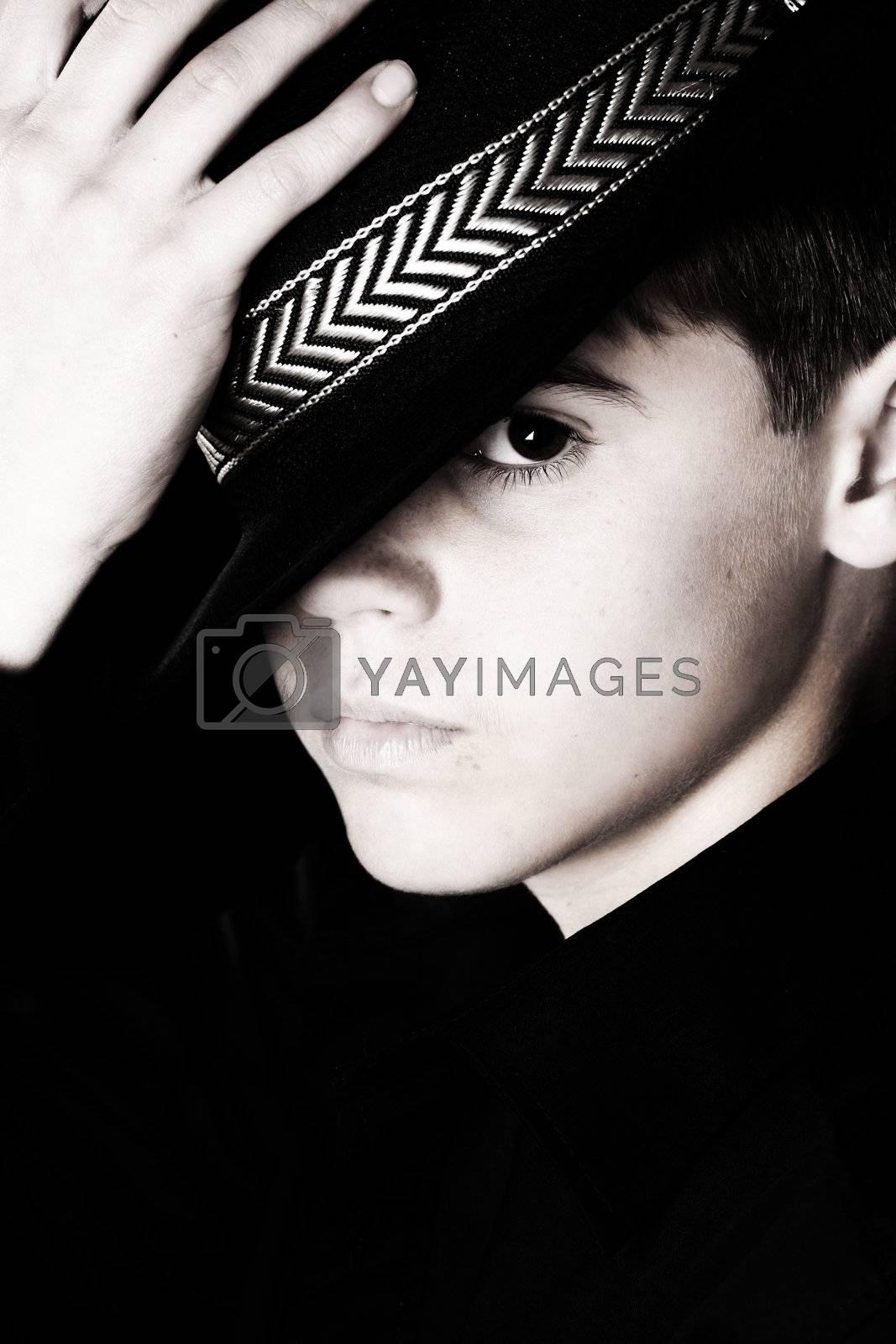 Teenage boy wearing a black hat in casual wear