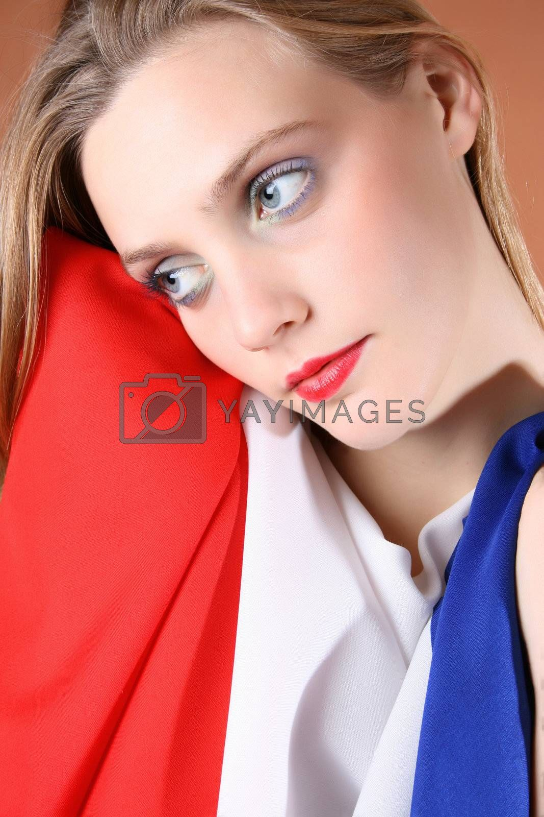 Beautiful young female covered by a French Flag