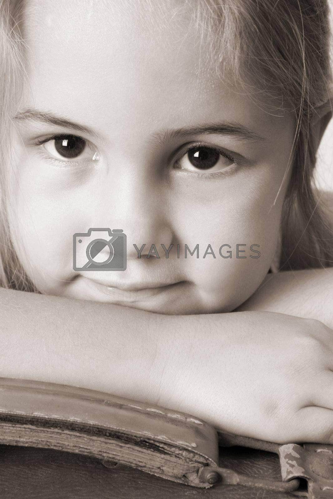 Cute girl resting head on arms