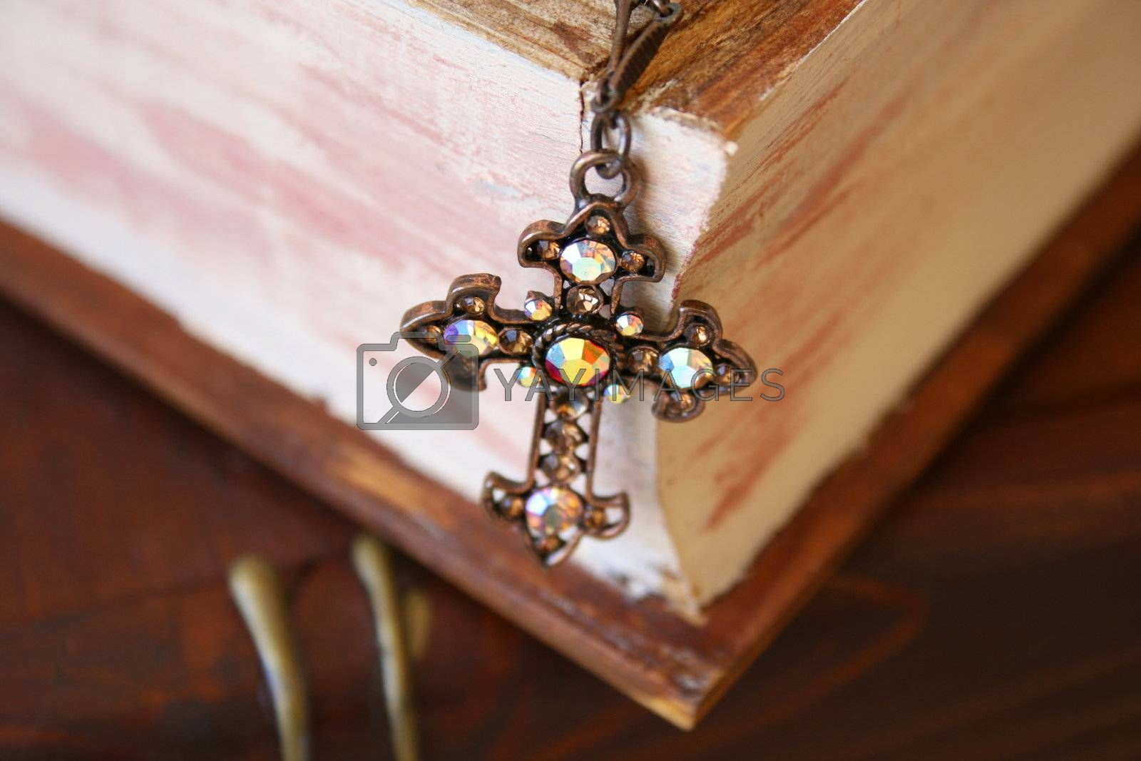 Close up of cross in the form of Jewellery on a wooden Jewellery box