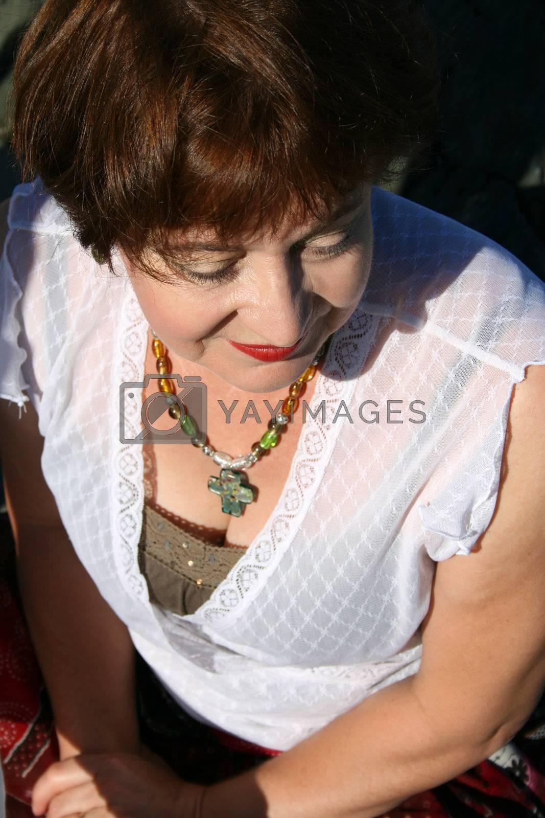 Beautiful mature brunette female on the beach