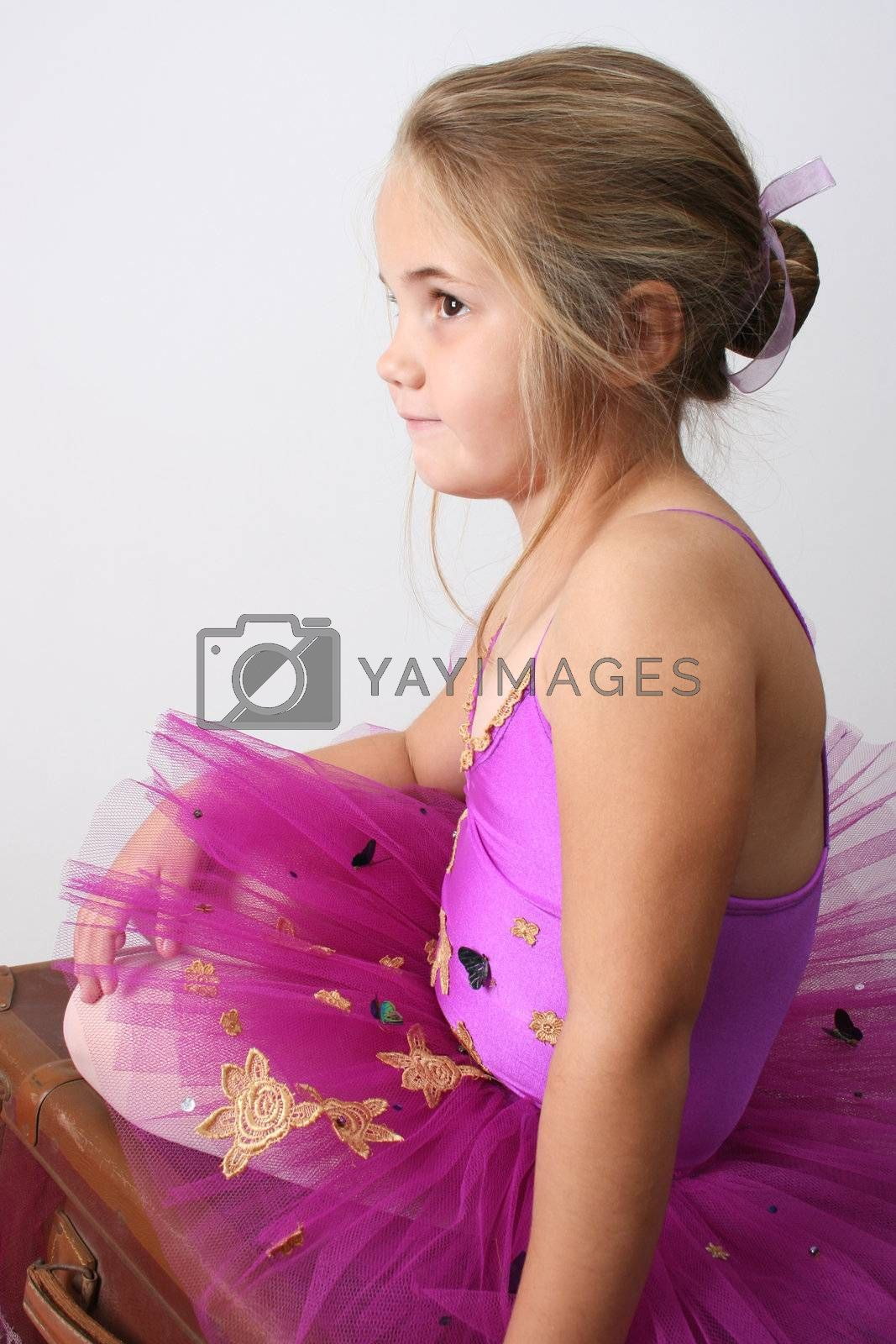 Young girl wearing a tutu dreaming of becoming a ballet dancer