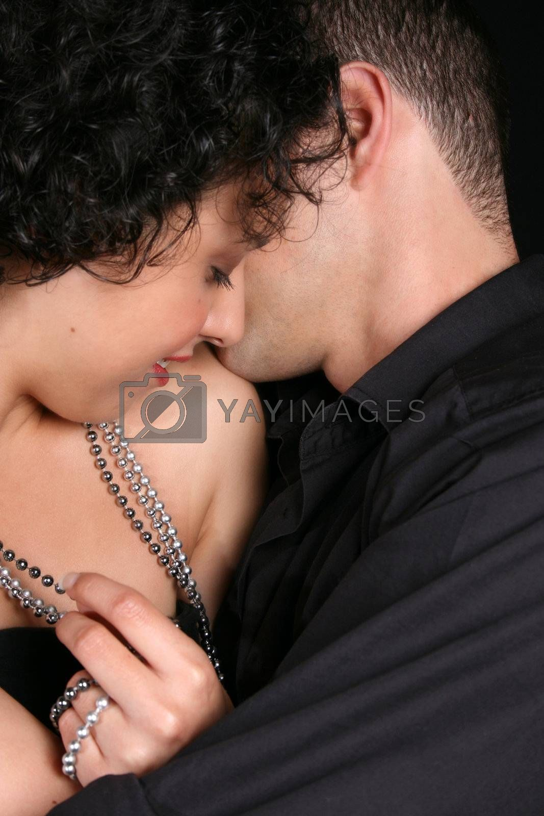 Loving couple in an embrace, female looking down