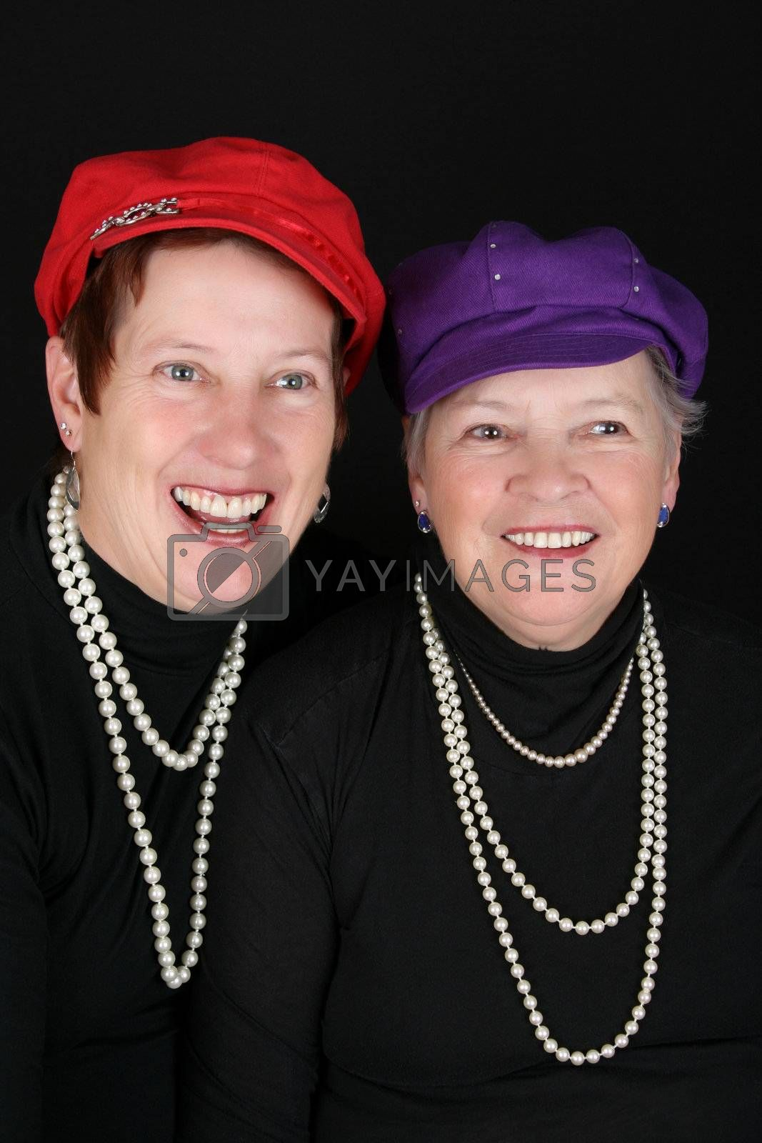 Adult mother and daughter wearing red and purple hats