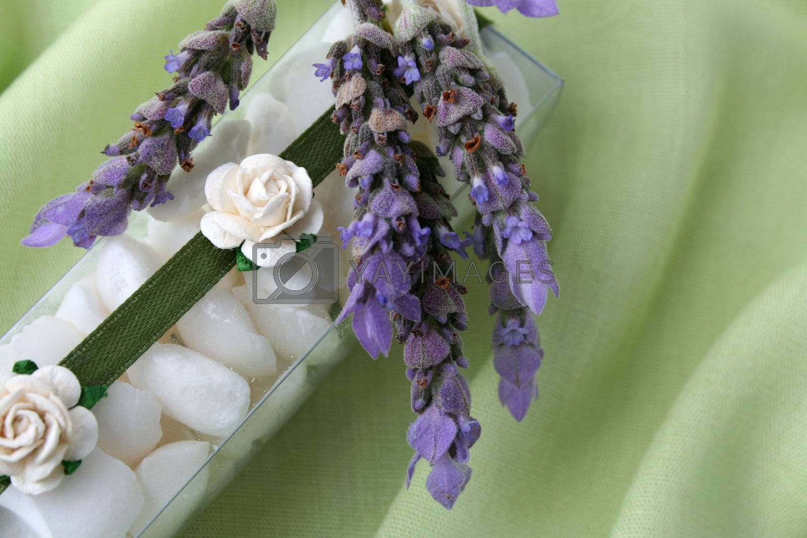 White bath crystals in a PVC box decorated with flowers