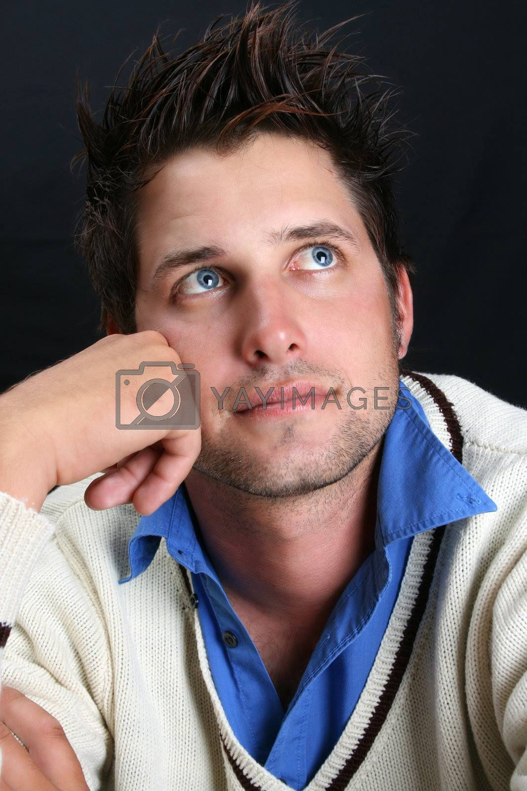 Male model in studio against black background