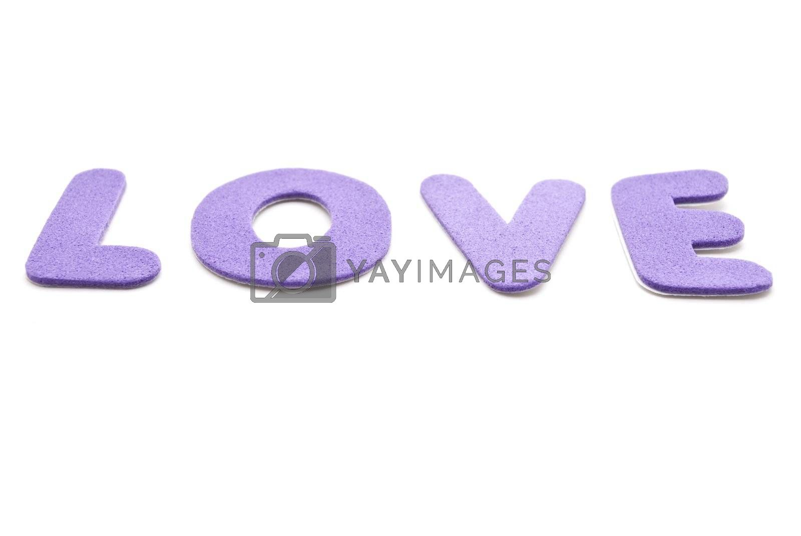 The word 'Love' spelled out in mauve lettering  on a white background.