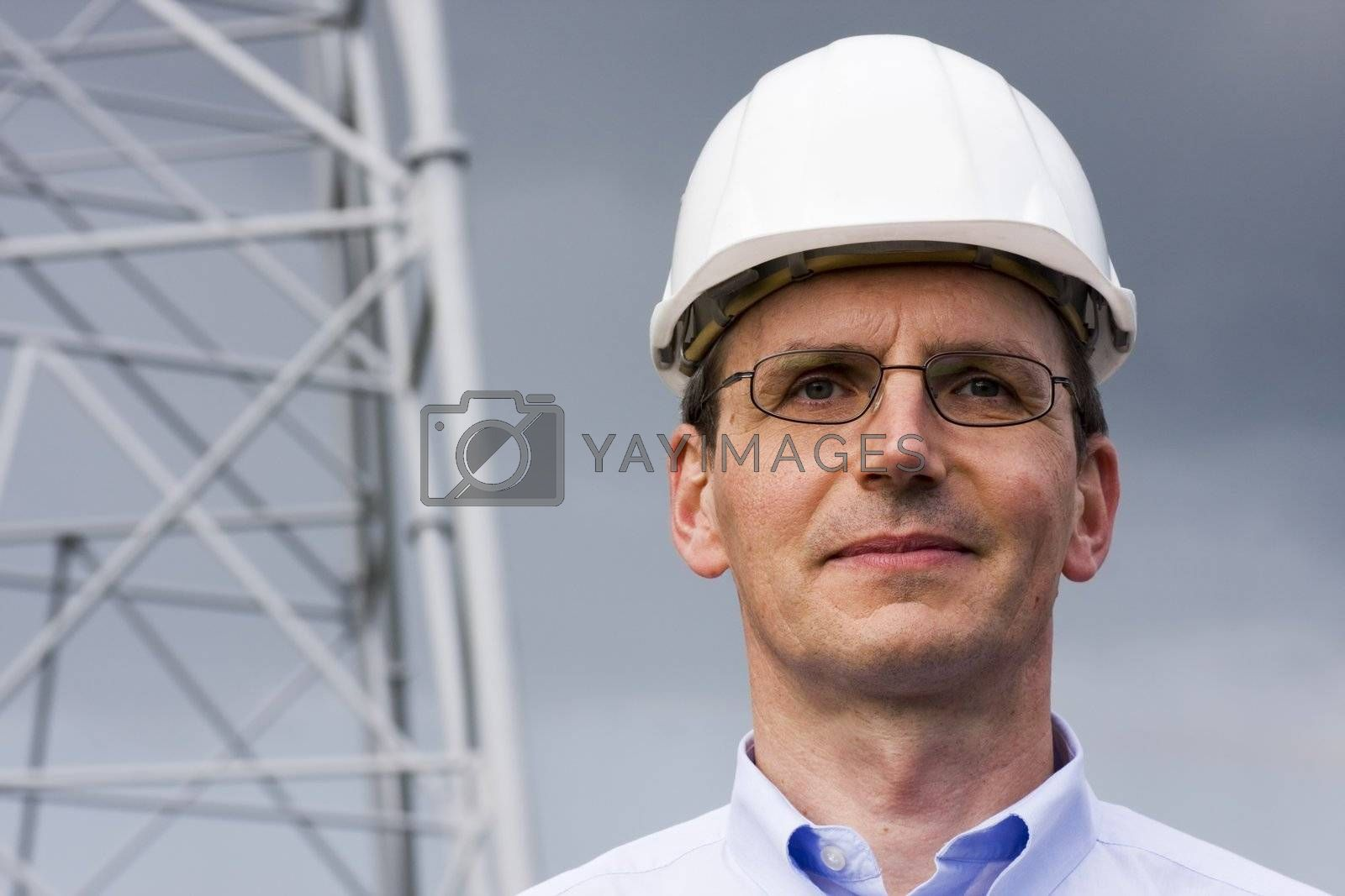 Smiling engineer in front of construction of steel