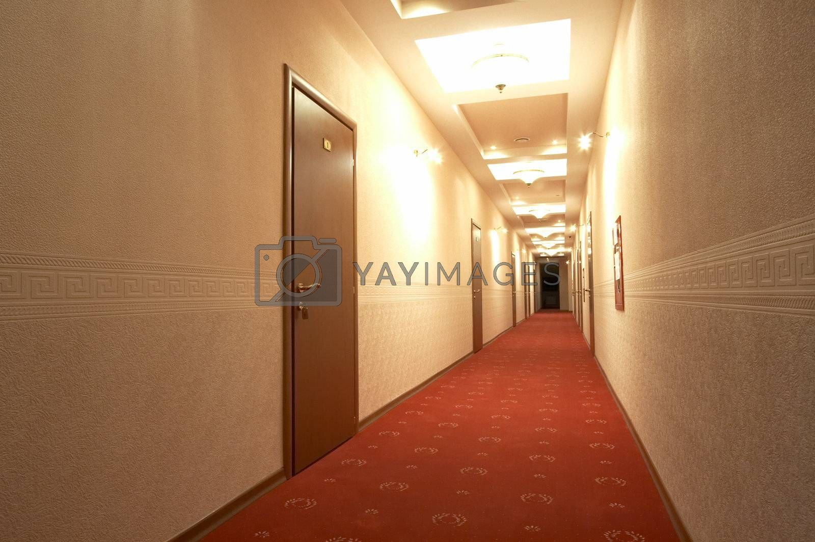 Corridor with a red carpet in hotel