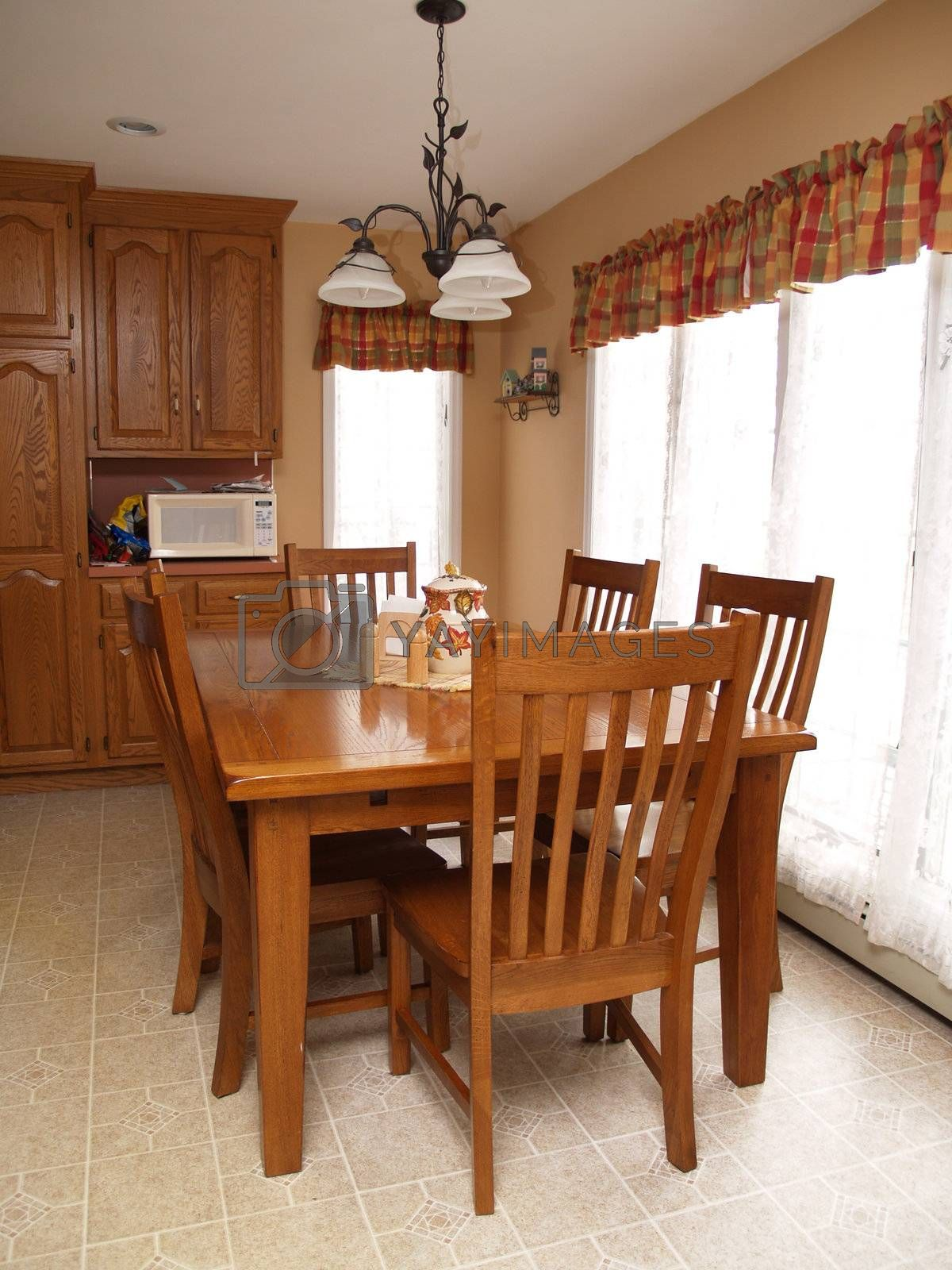wood table and chairs in a modern kitchen