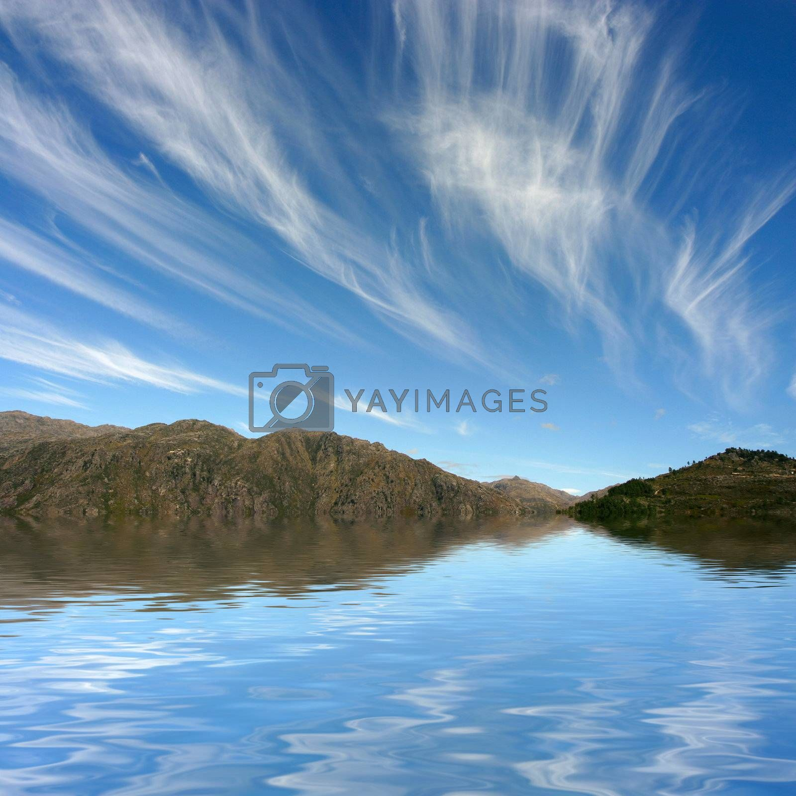 Photo of a dreamy sky, reflected on water.