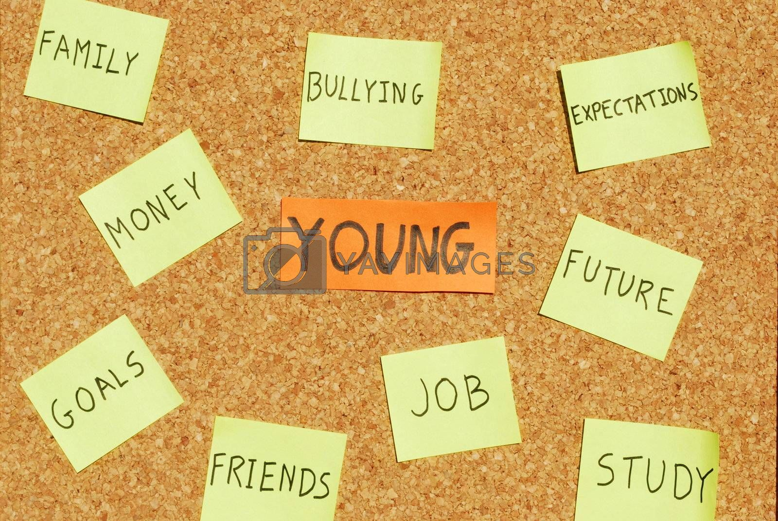 Royalty free image of Young concerns on a cork board by luissantos84