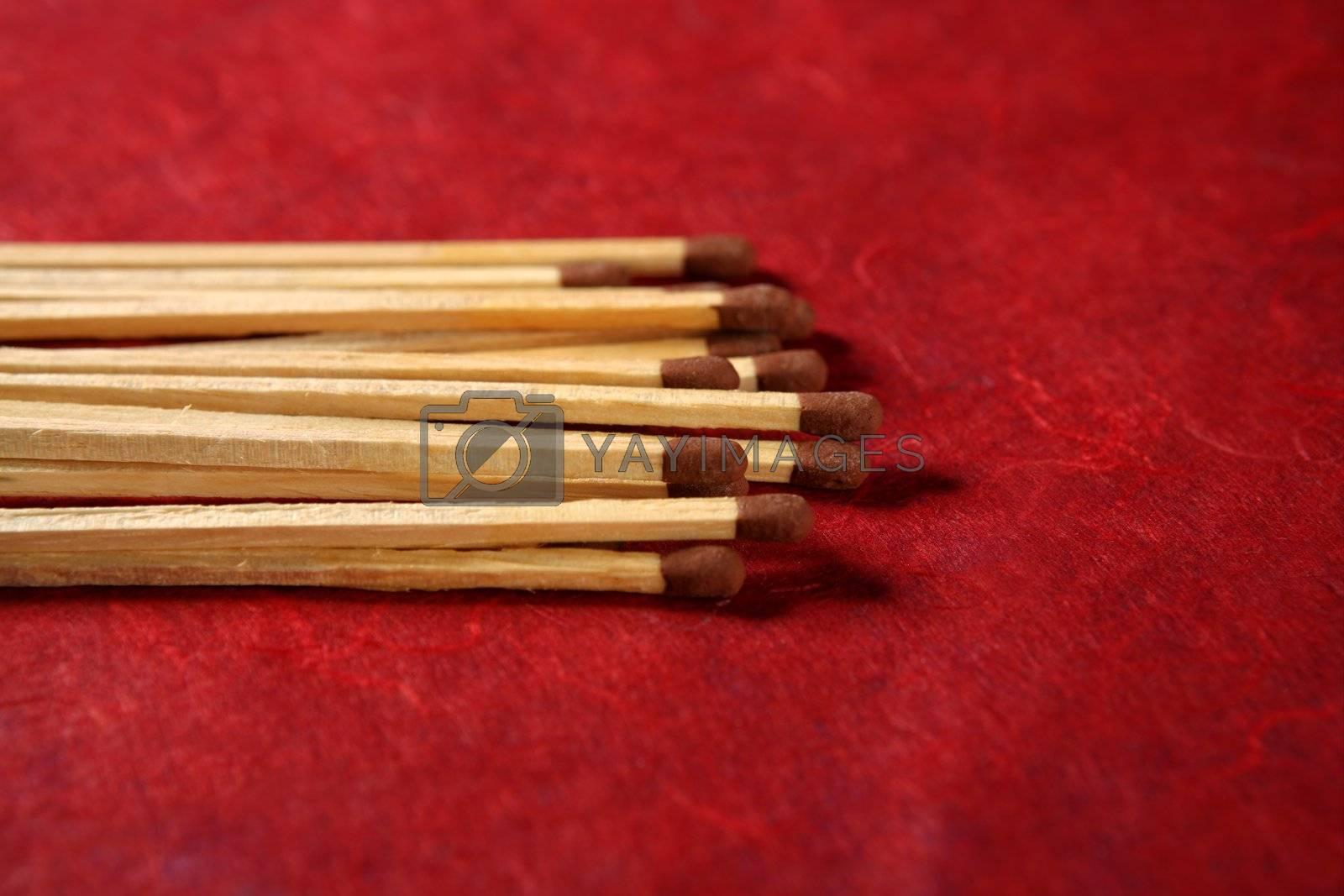 Royalty free image of Light wooden matches arrangement by lunamarina