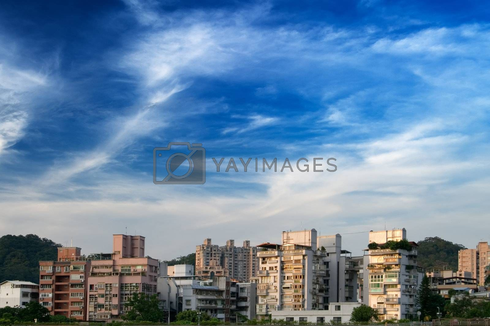 Royalty free image of apartment and blue sky by elwynn