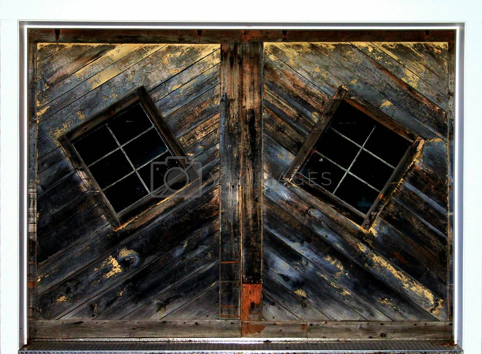 Old rustic barn door with odd windows
