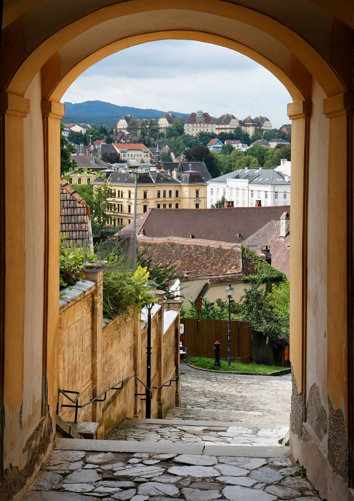 Royalty free image of View of the Melk town in Austria through the archway by slavapolo