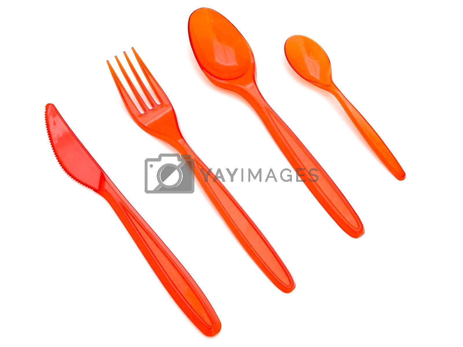 Royalty free image of plastic fork knife and spoons by SNR