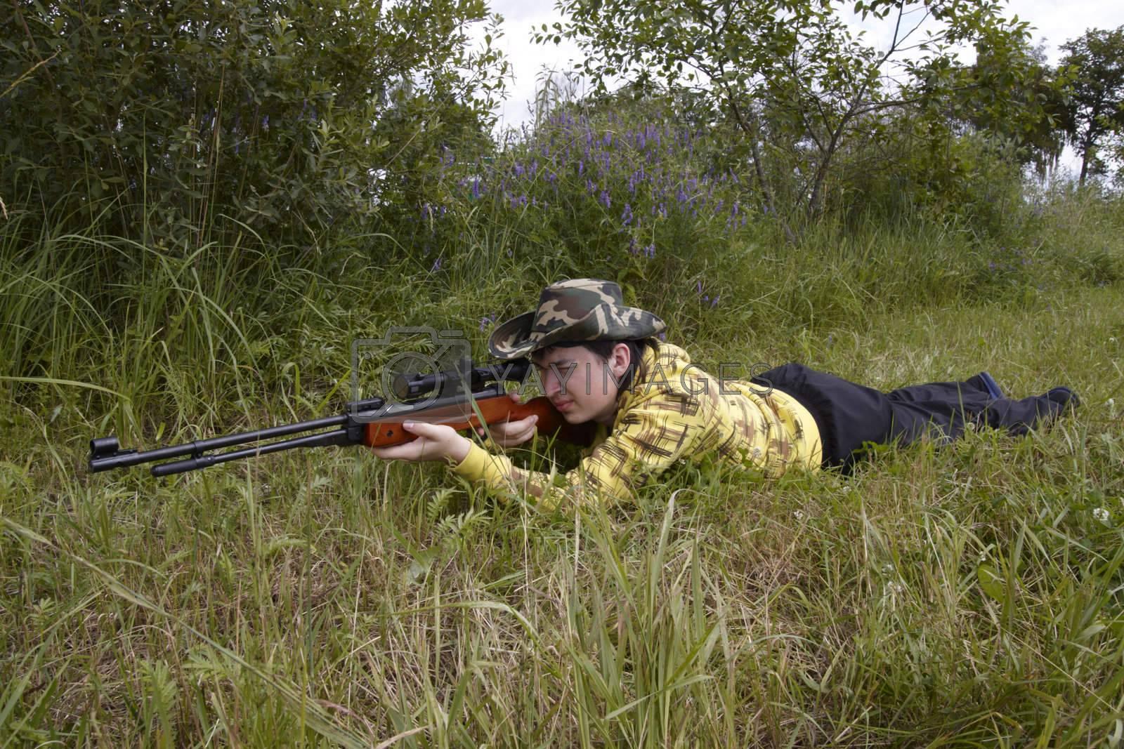 Royalty free image of Hunter shooting up by Nikonas