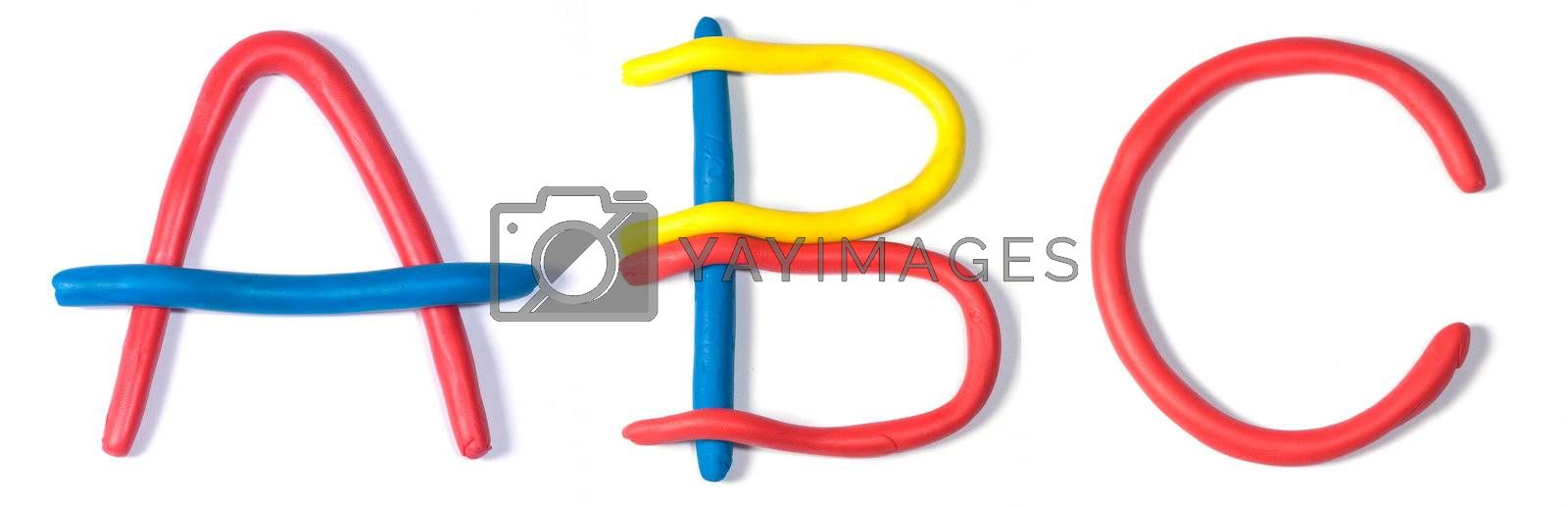 The characters a, b and c shaped in primary coloured plasticine, isolated on white.