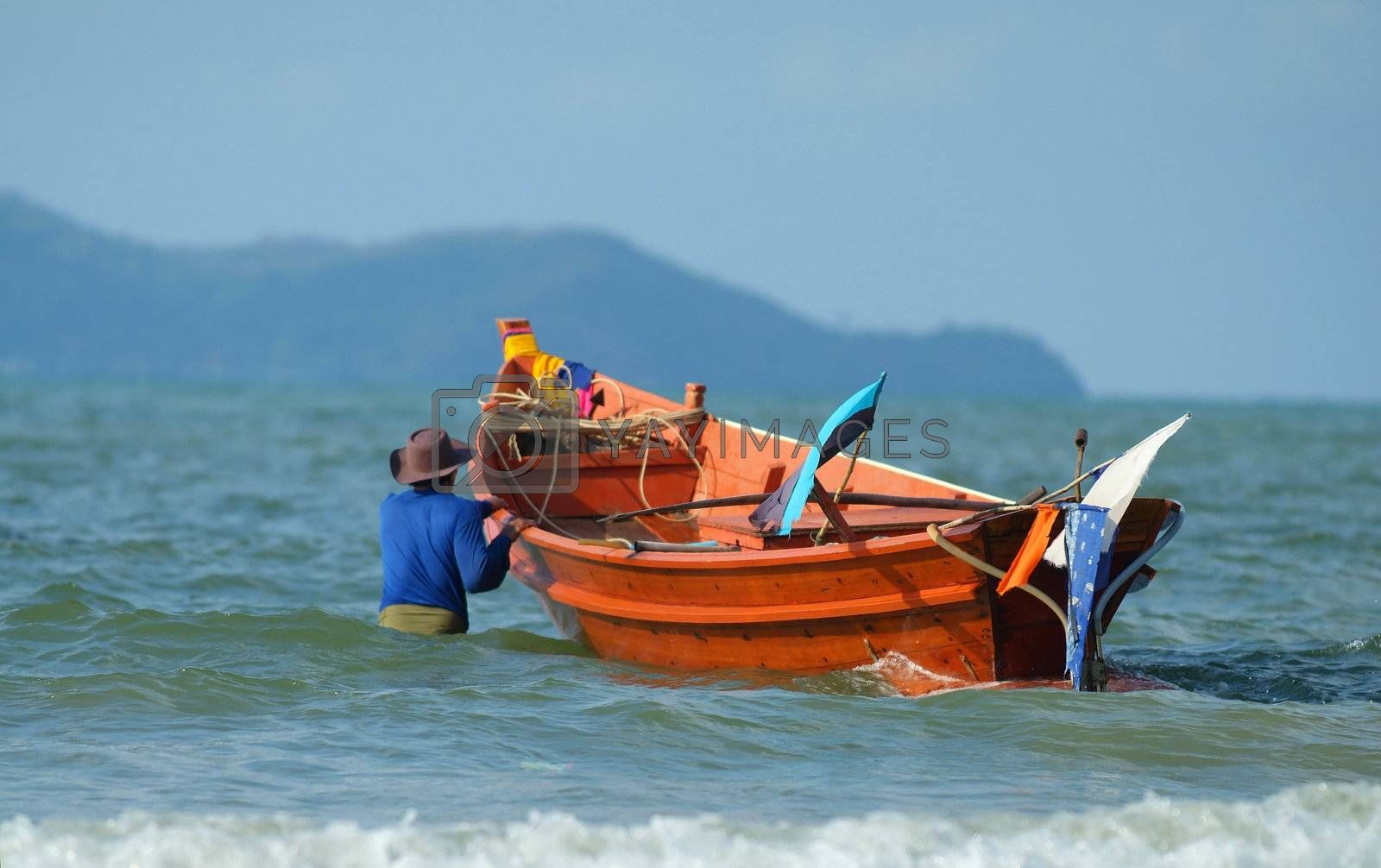 Fisherman taking his boat to sea by epixx