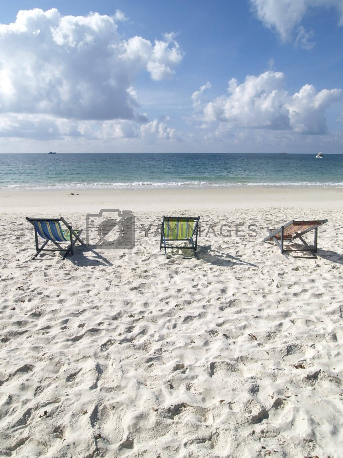Chairs on the beach by epixx