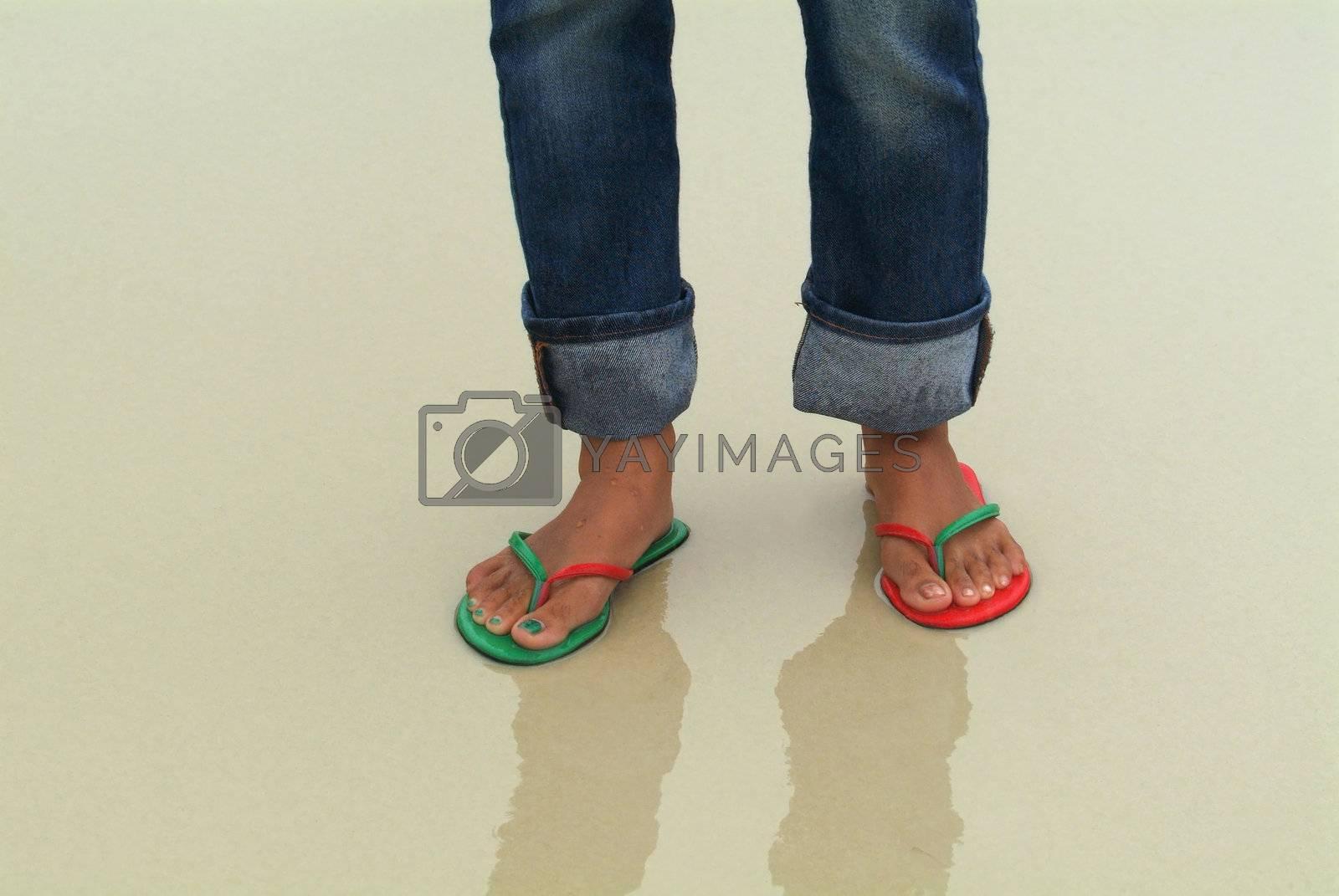 Feet in wet sand by epixx