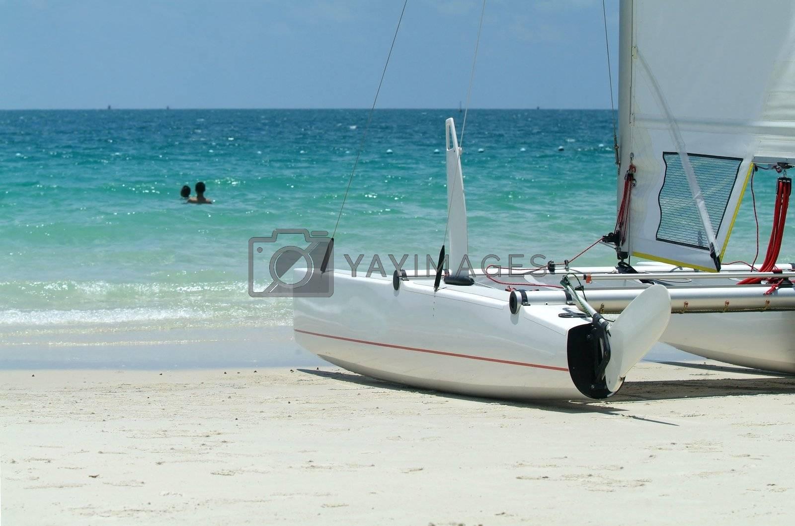 Catamaran on the beach by epixx