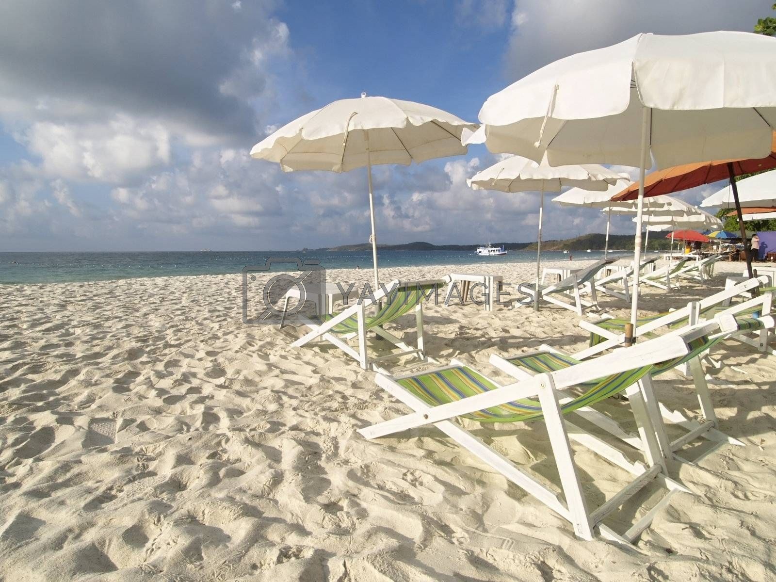 Chairs and parasols on the beach by epixx