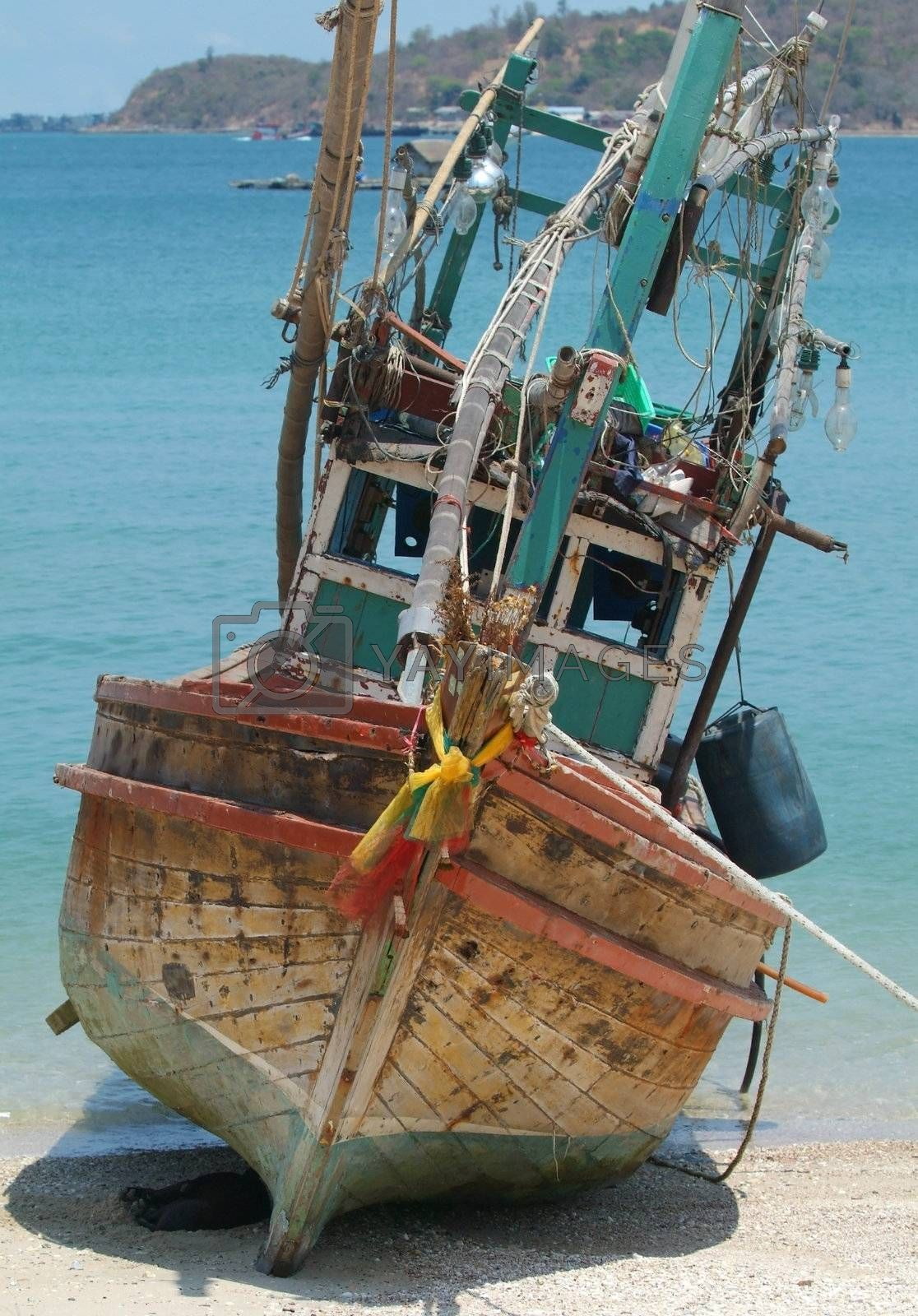 Fishing boat on the beach by epixx