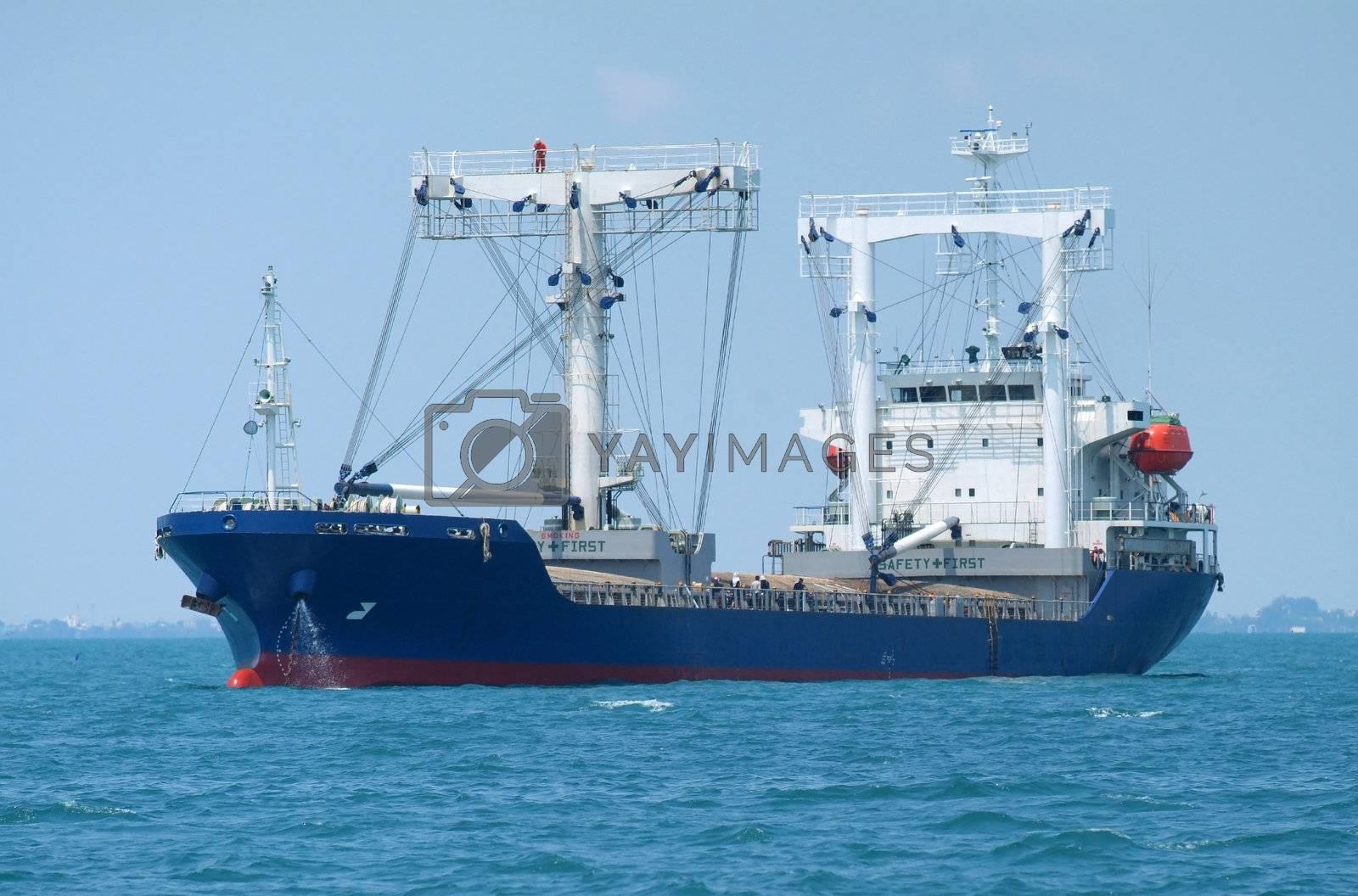 Bulk ship at anchor by epixx