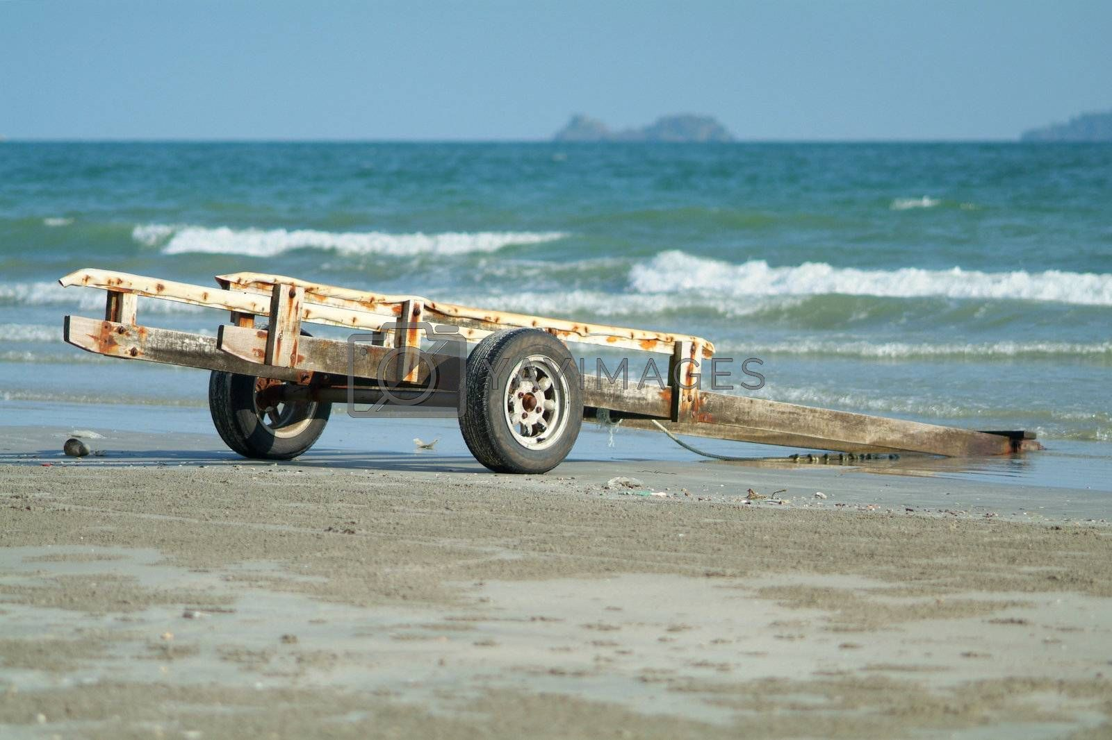 Boat trailer on the beach by epixx