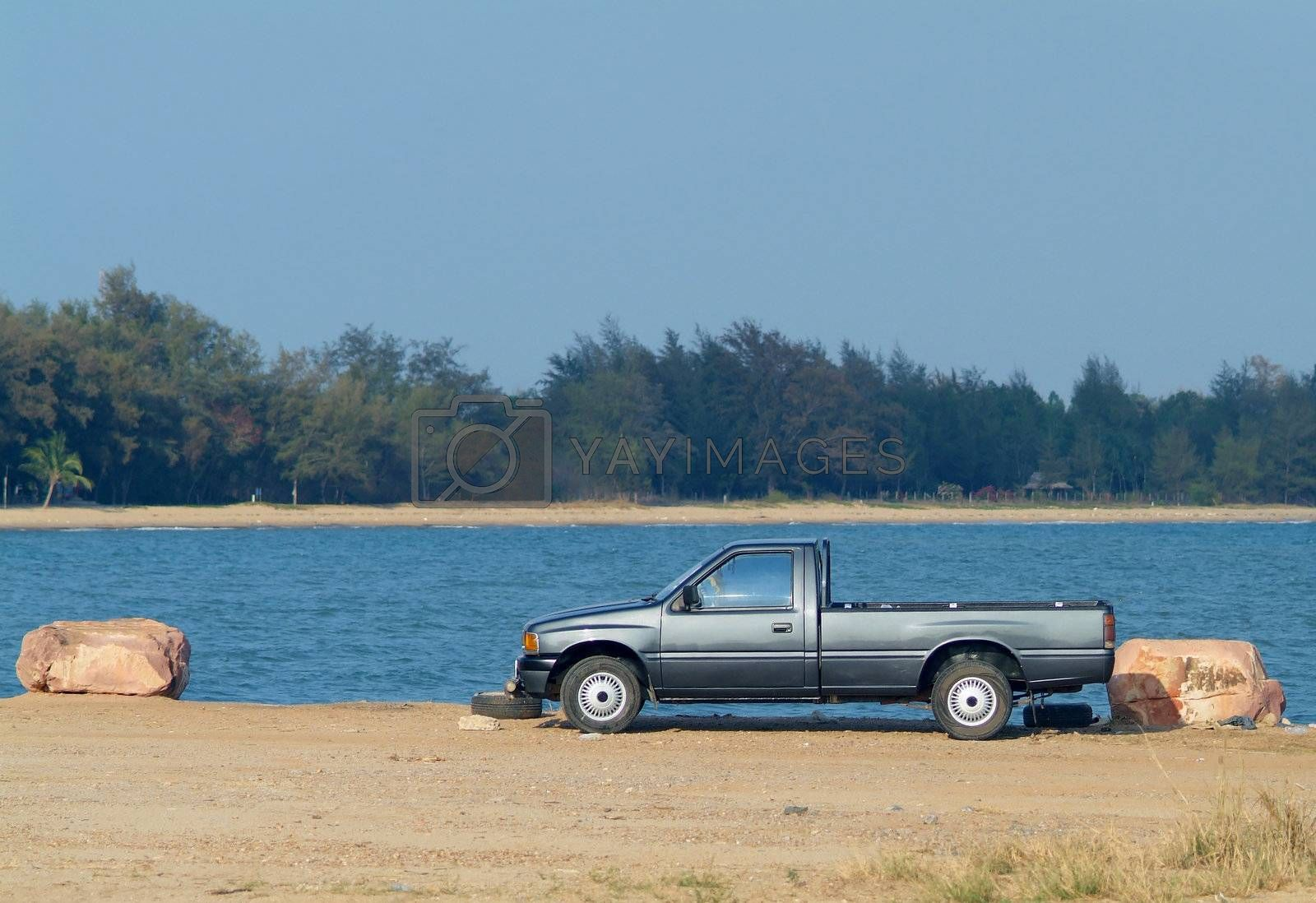 Pickup truck at the waterfront by epixx