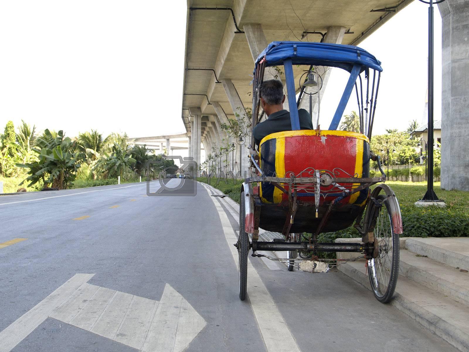 Trishaw under a bridge by epixx