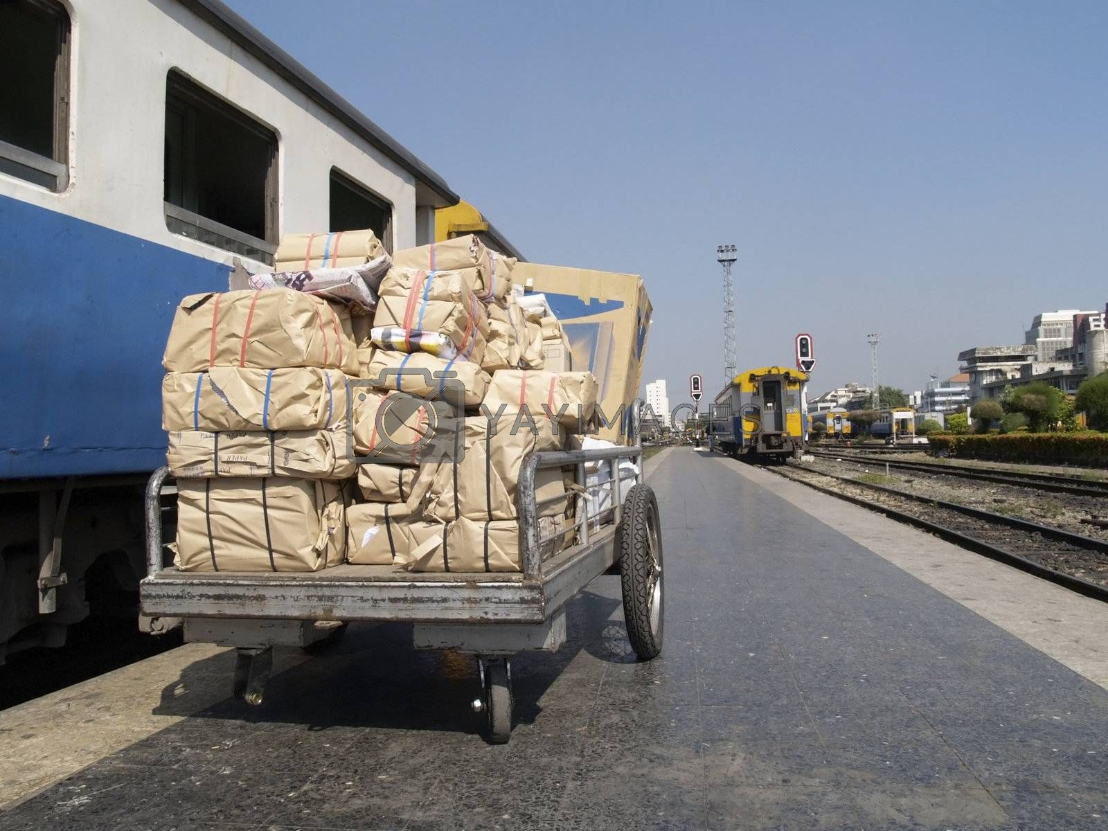 Packages at a railway station by epixx