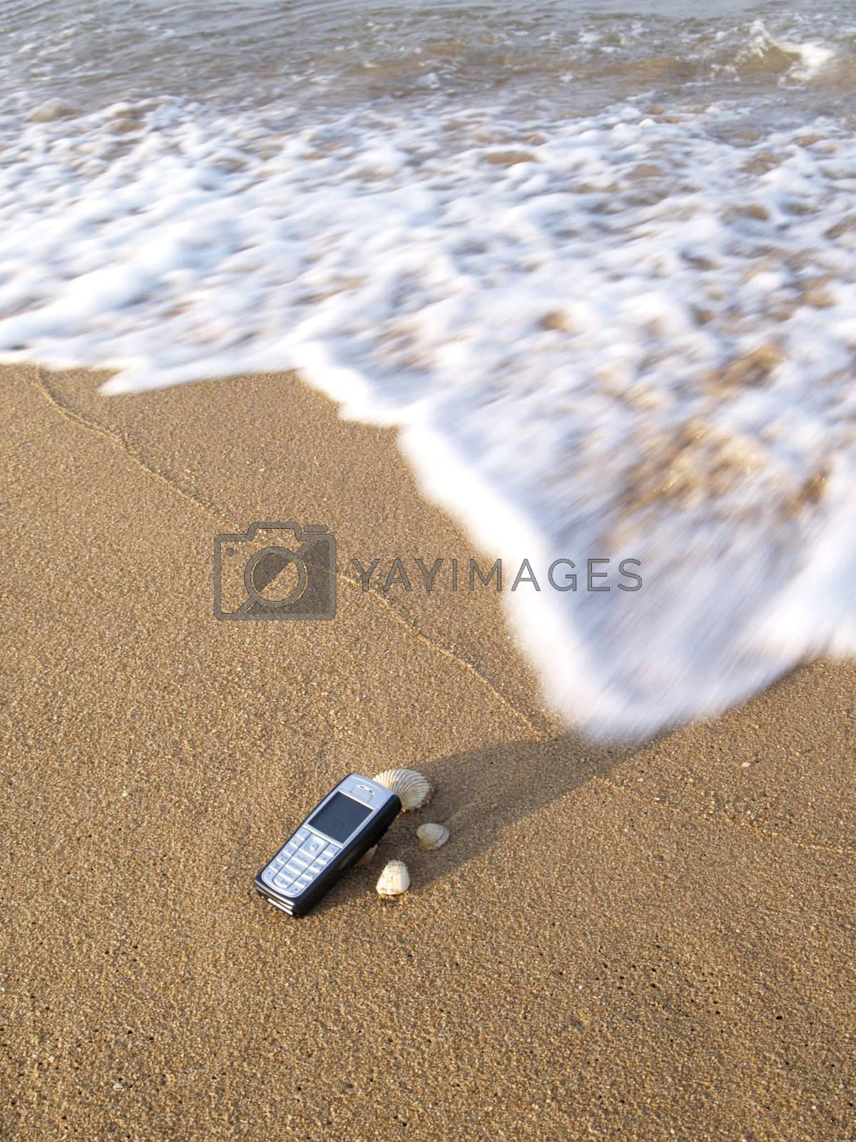 Mobile phone and the sea by epixx