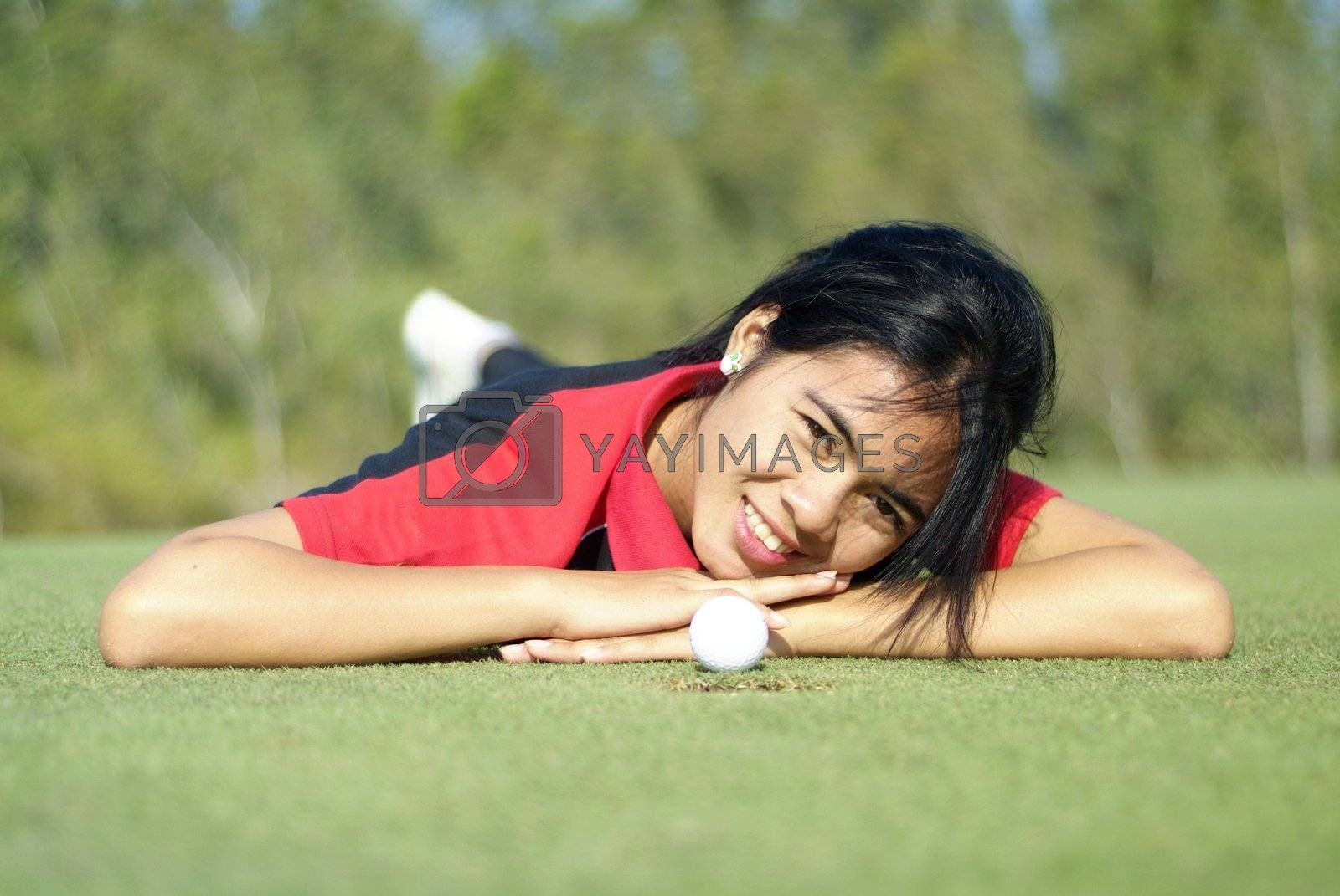 Female golf player on green by epixx