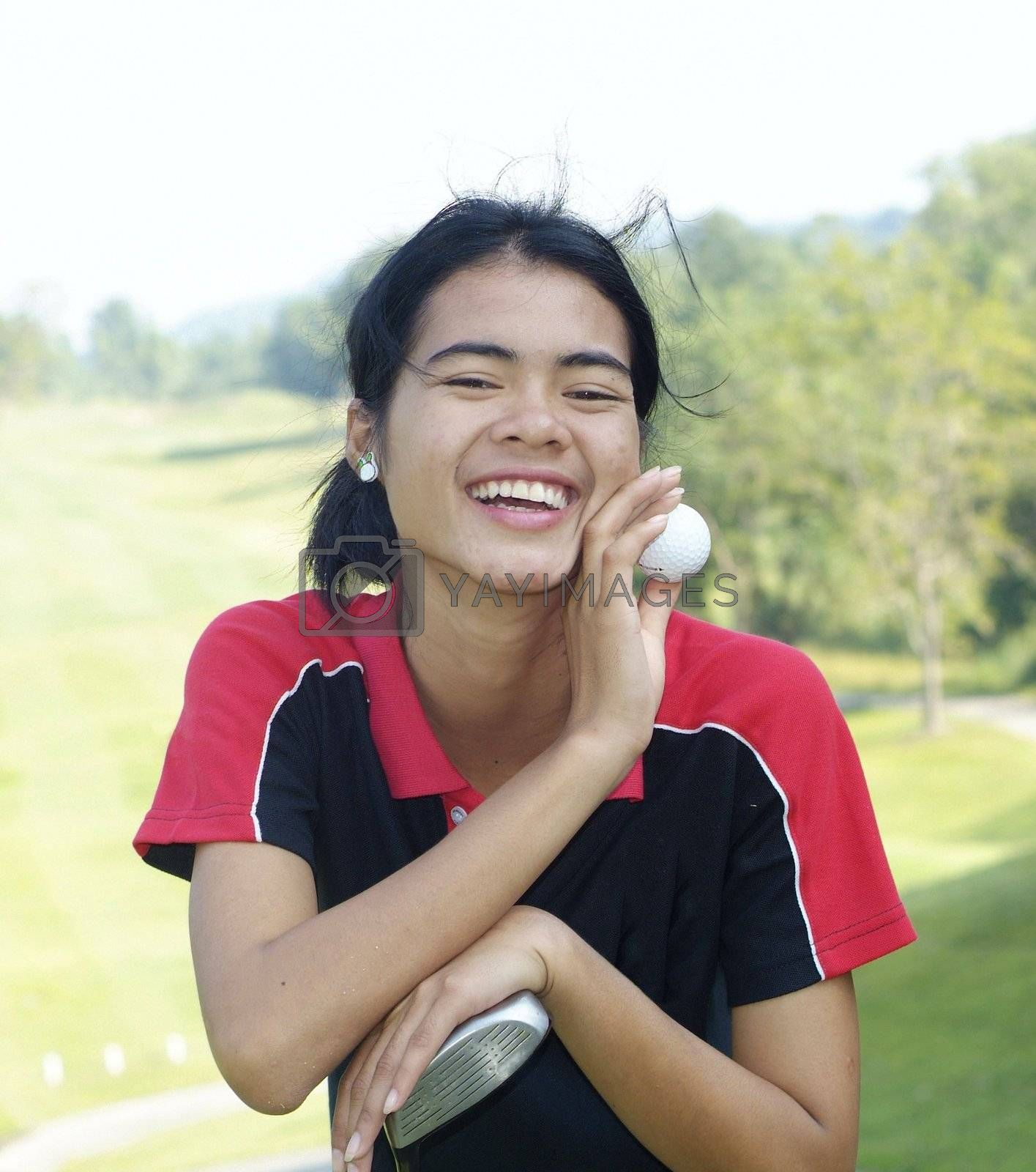 Female golf player laughing by epixx