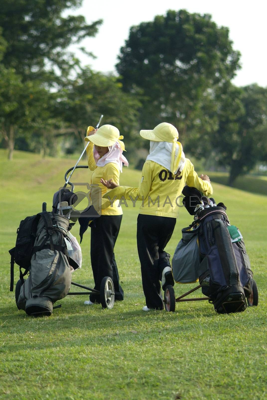 Two caddies at a golf course by epixx