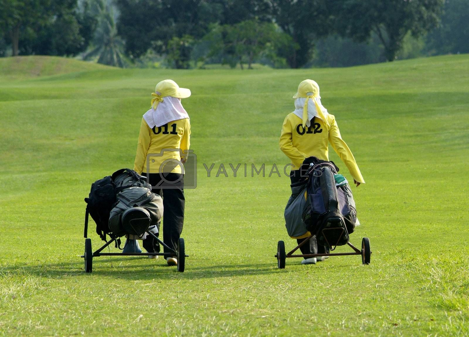 Two caddies on a golf course by epixx