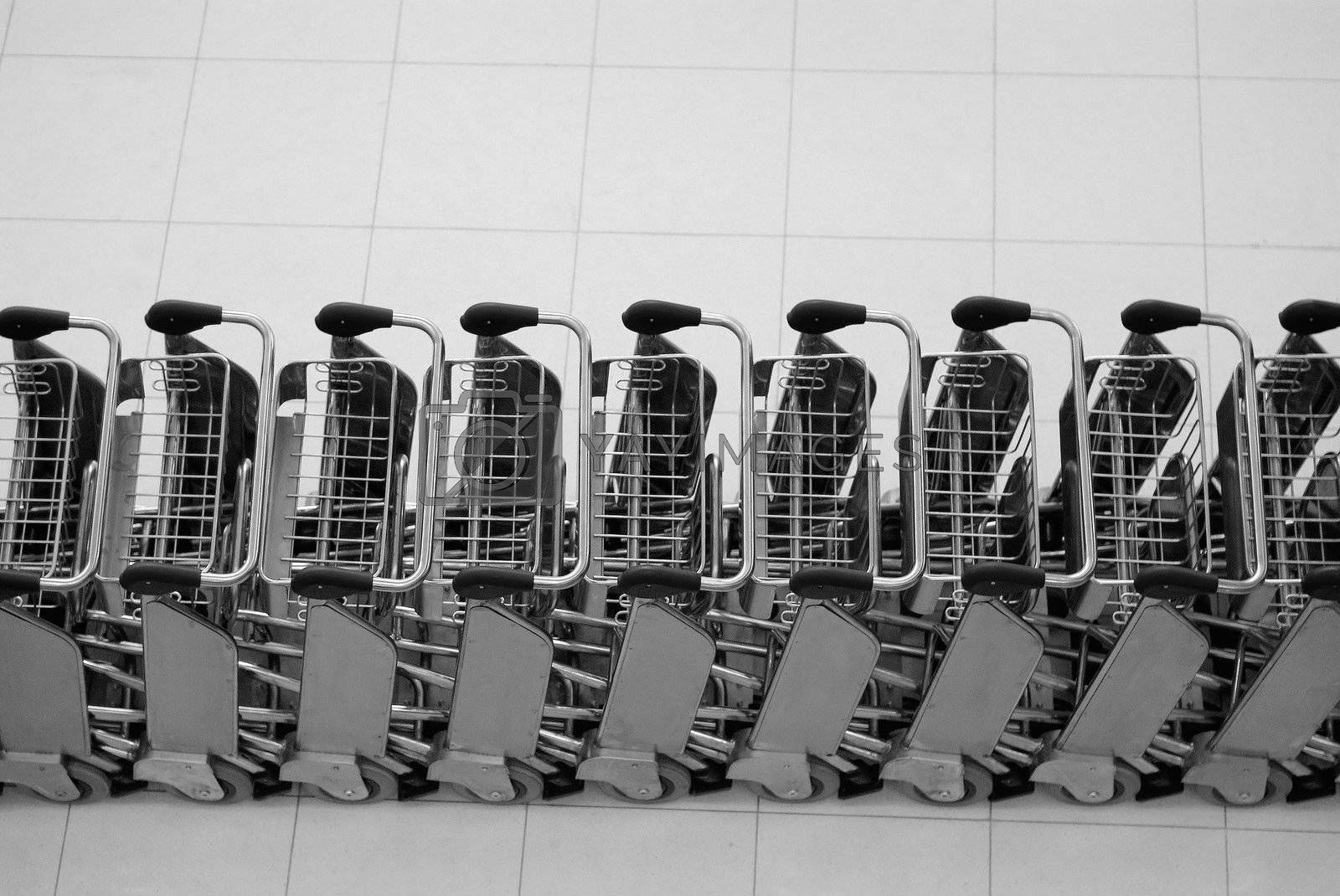 Baggage trolleys at an airport by epixx