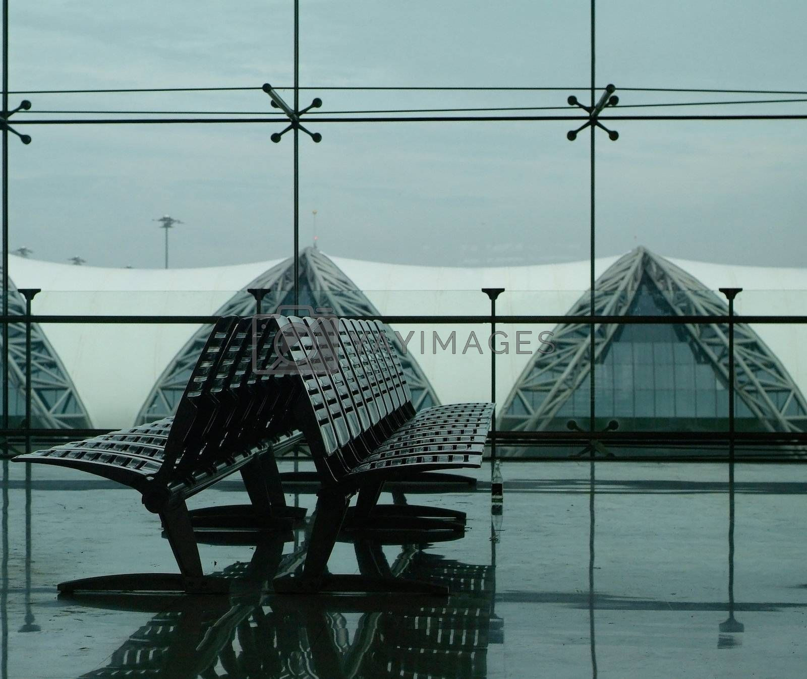 Seats at an airport terminal by epixx